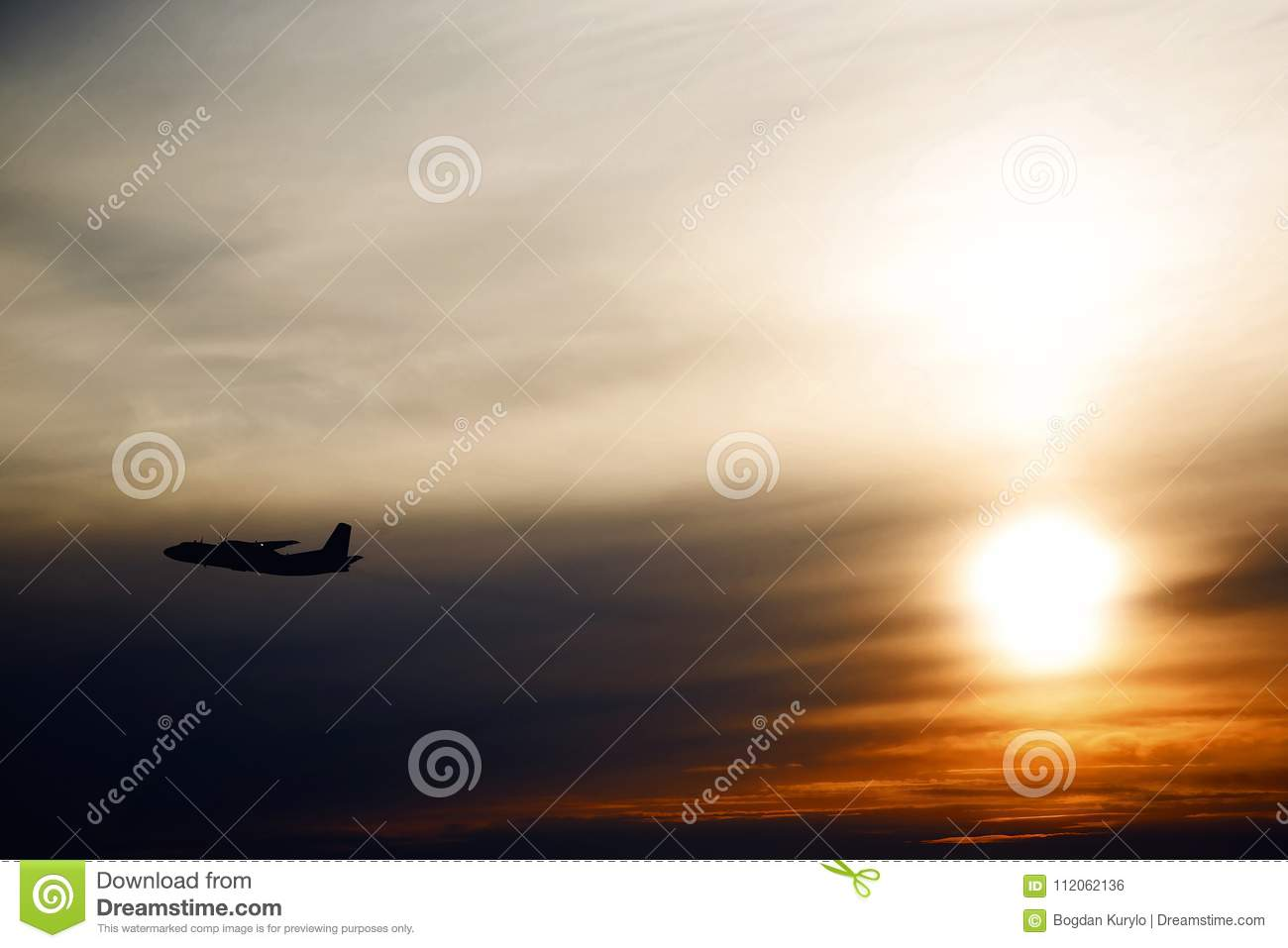 Plane Flying At Sun In Sunset Sky  Airplane In The Air