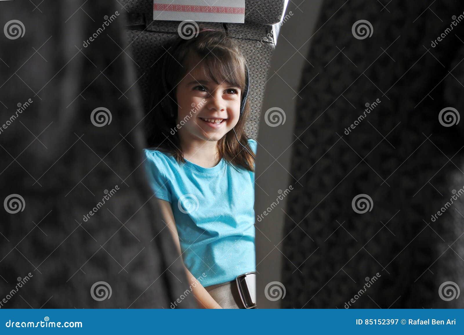 Plane passenger child watching inflight movie