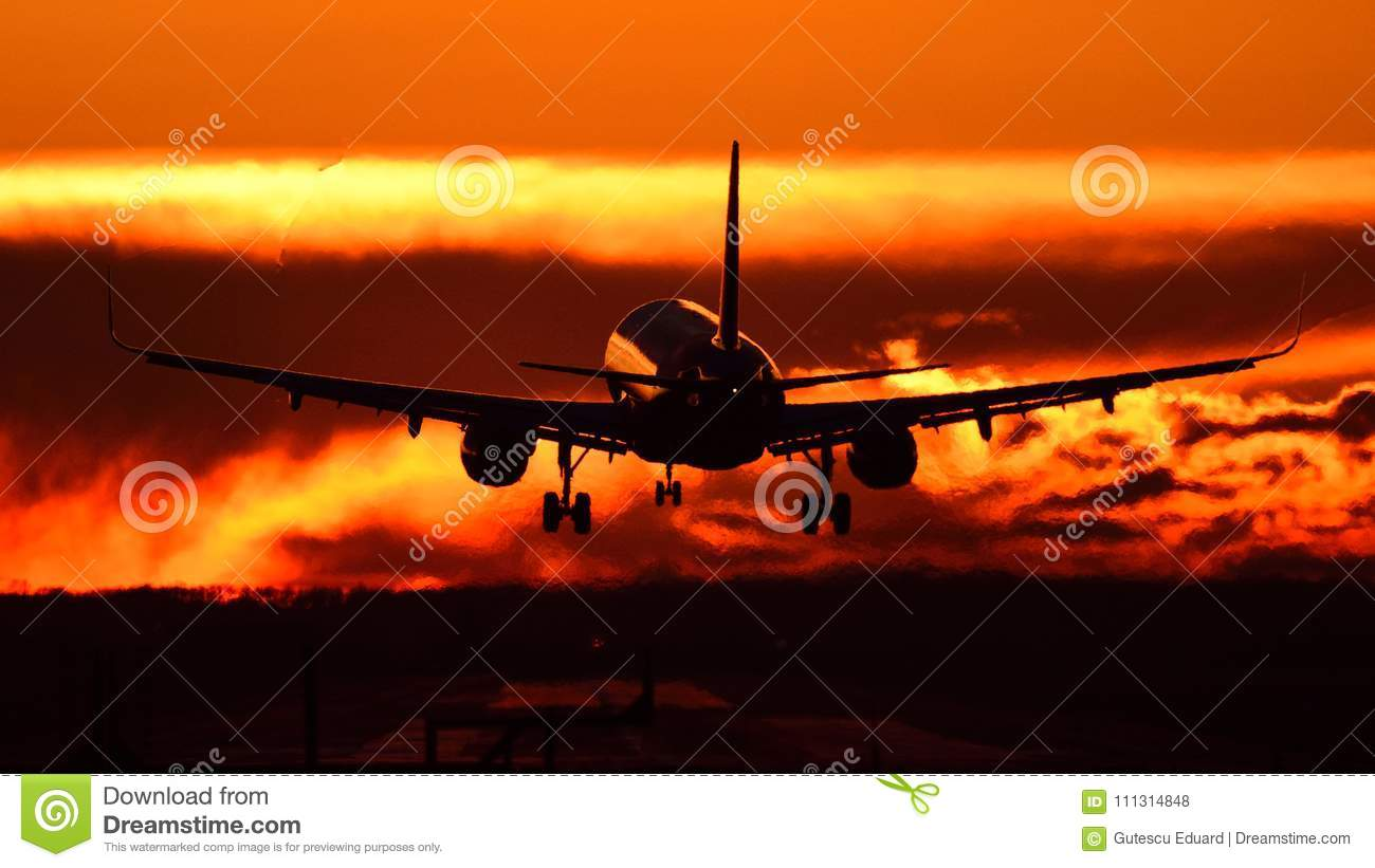 Plane spotting at Otopeni airport during sunset with red sky