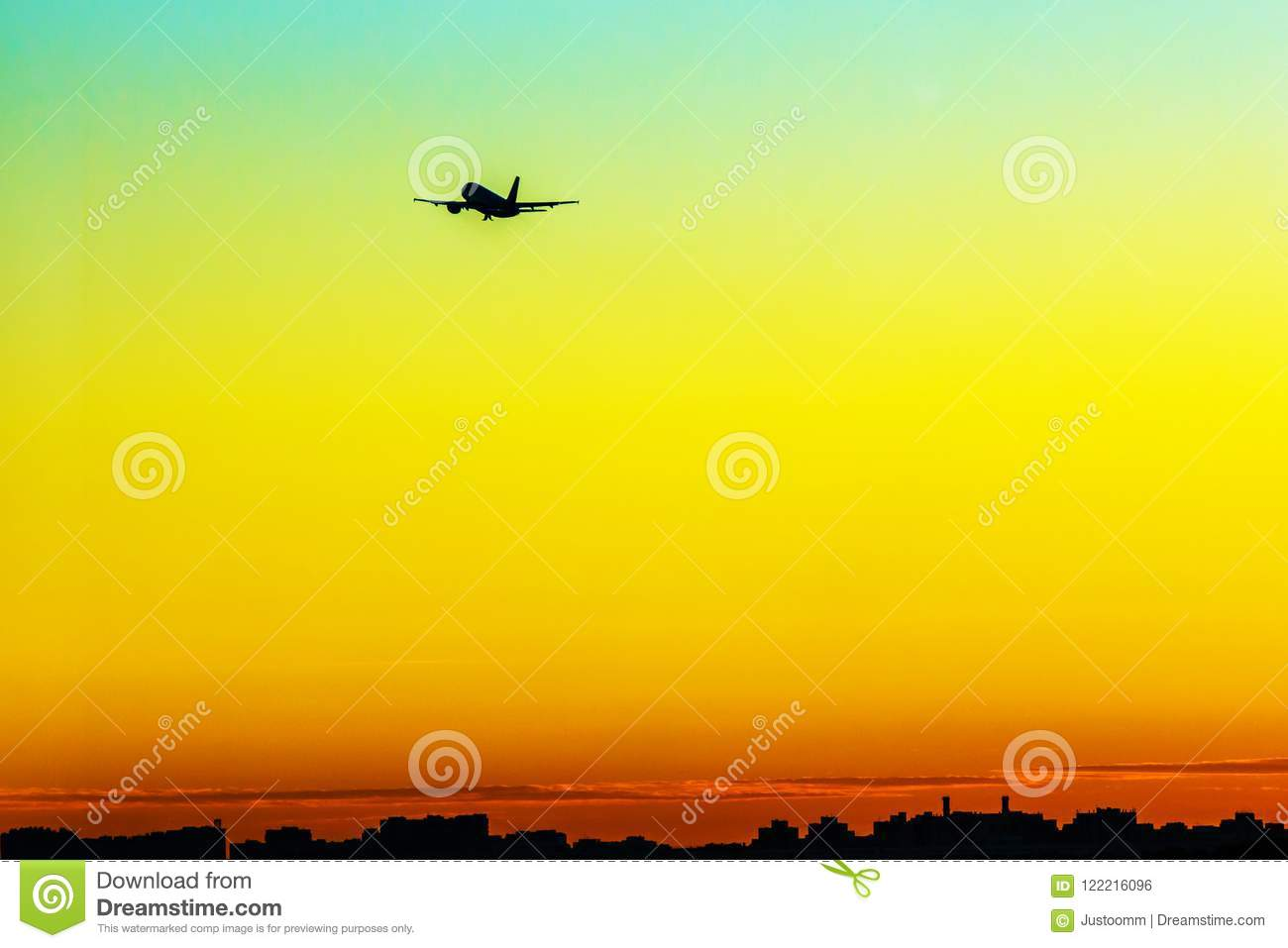 Plane taking off into yellow sunset