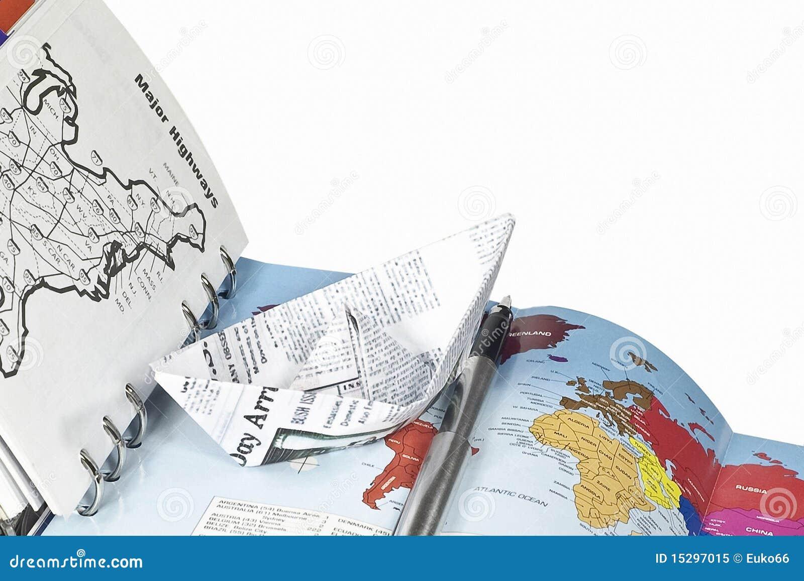 Planification de course (un cahier et un bateau de papier)