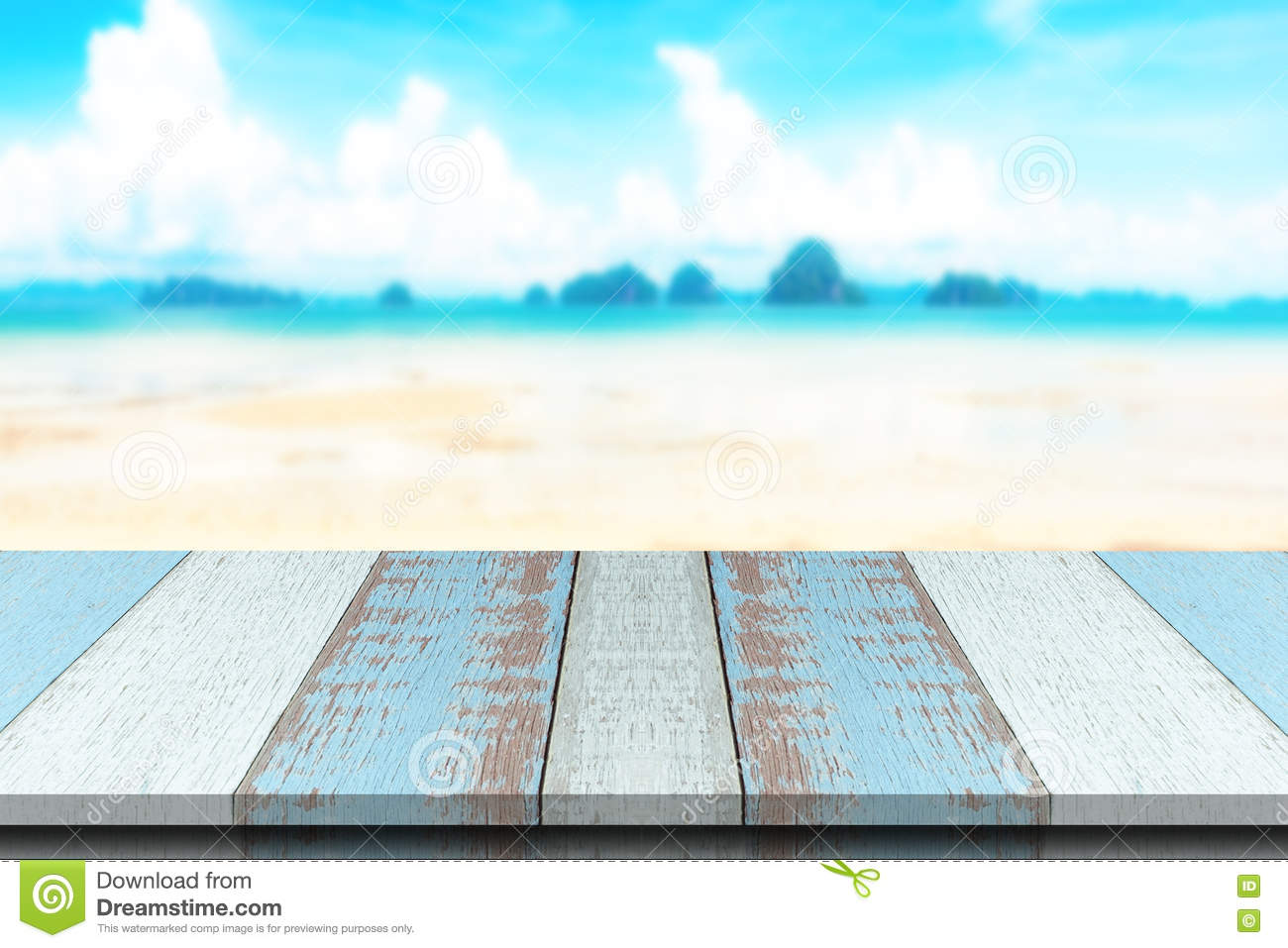 Plank wood or table top with Summer beach and sea water background.