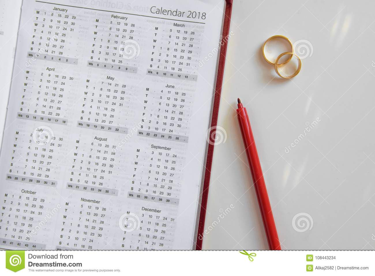 planning a wedding in 2018 calendar of 2018 and two wedding rings and on white