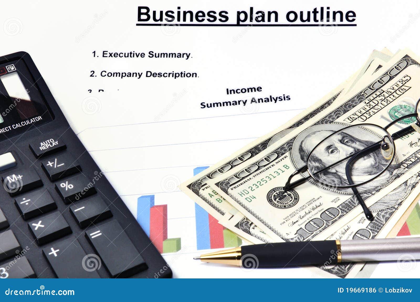 Plano empresarial com análise gráfica e dinheiro