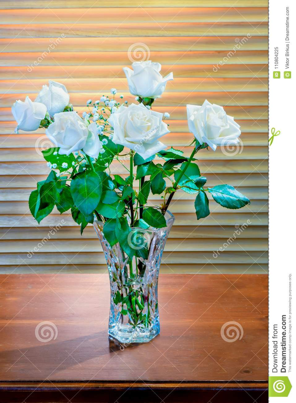 Bouquet Of White Roses With Green Leaves And Small White Flowers