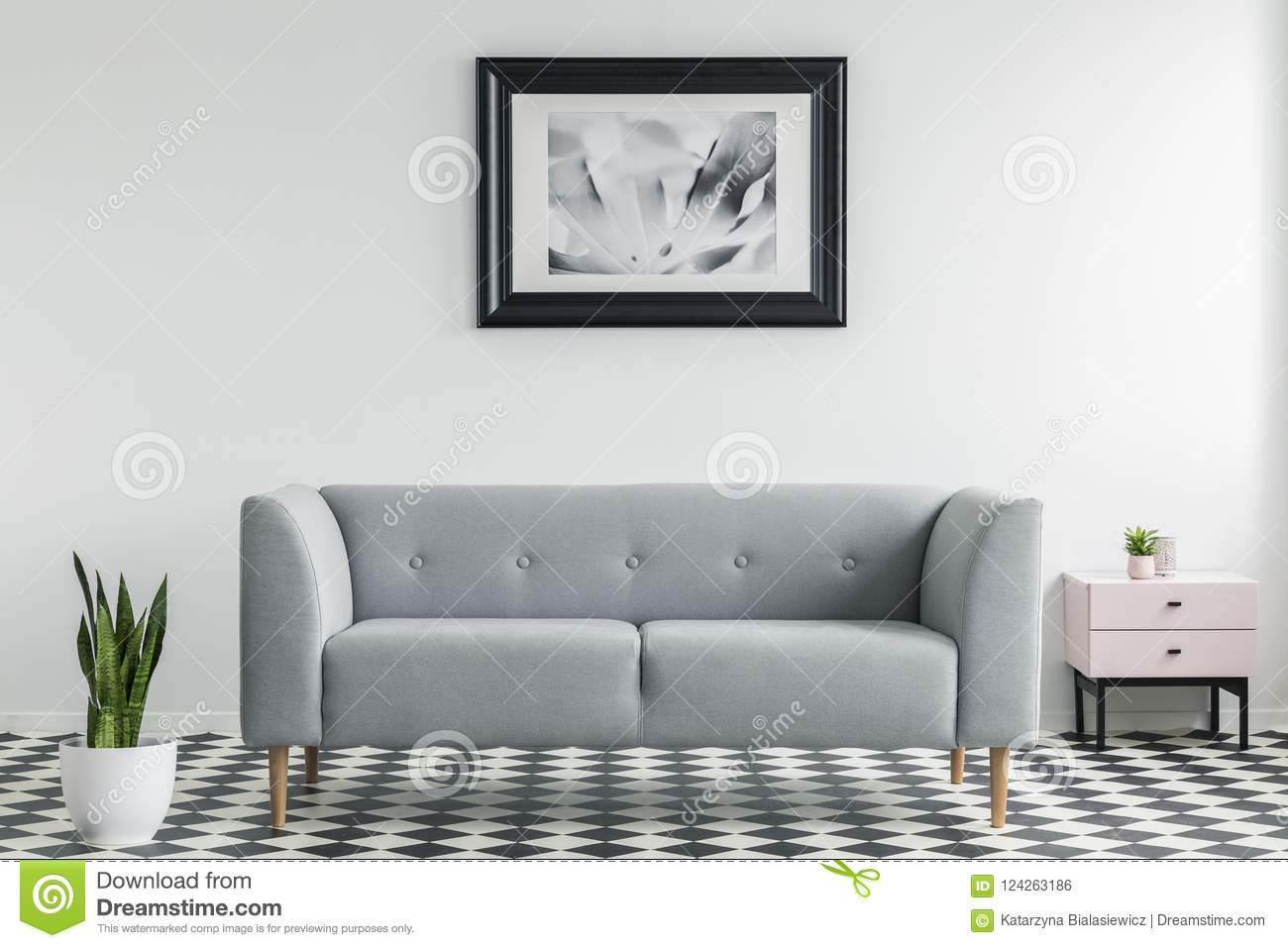 Plant Next To Grey Settee In White And Black Living Room Interior ...