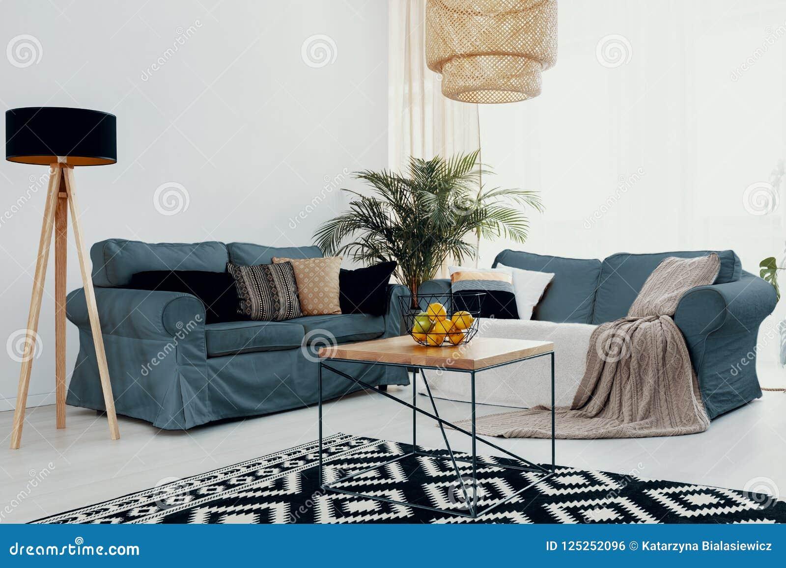 Plant On Wooden Table Near Green Corner Sofa In White Living Room ...