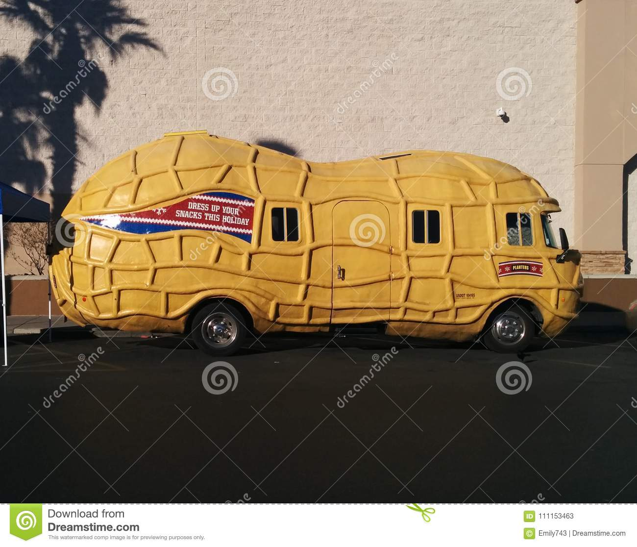 planters peanut mobile in parking lot with palm shadows editorial