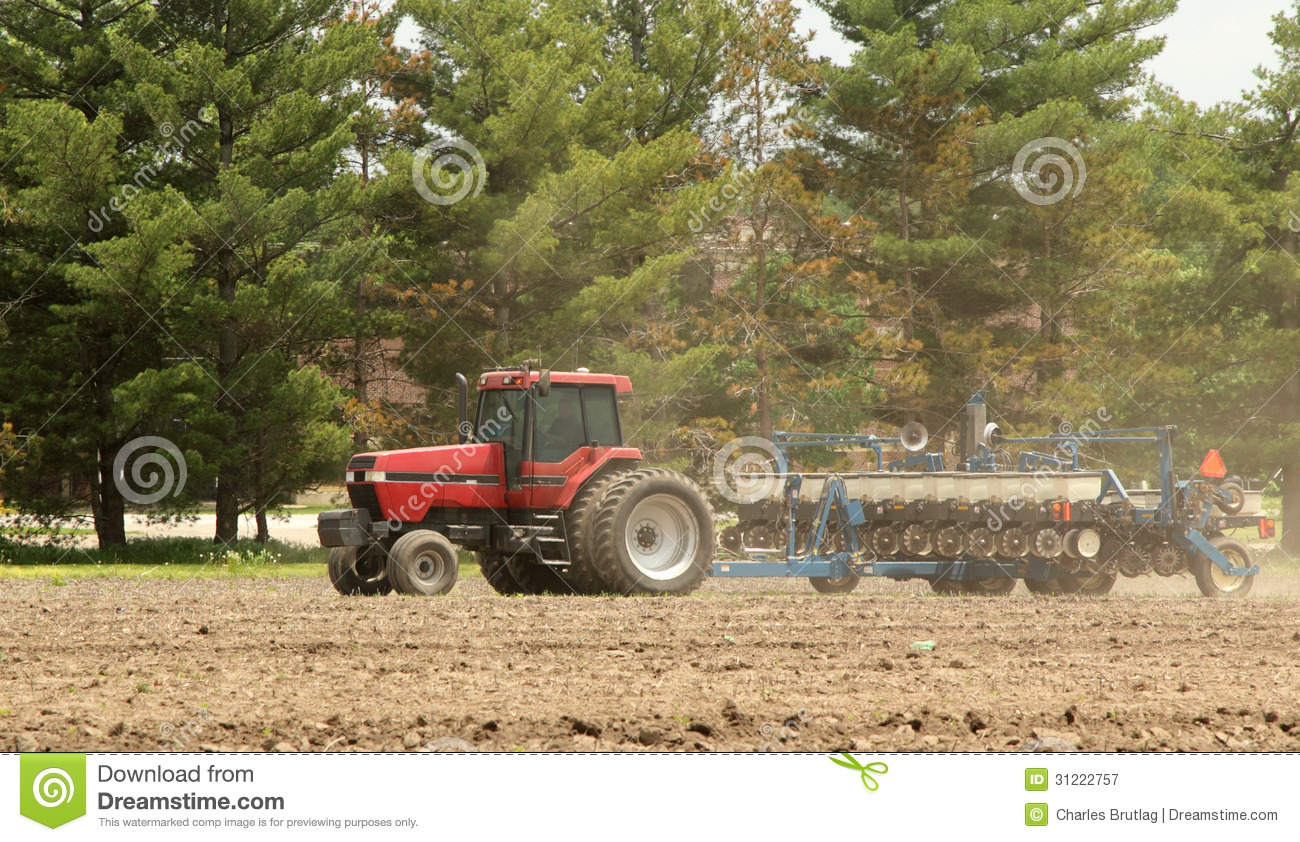 Tractor In Field Planting : Planting a farm field royalty free stock photography