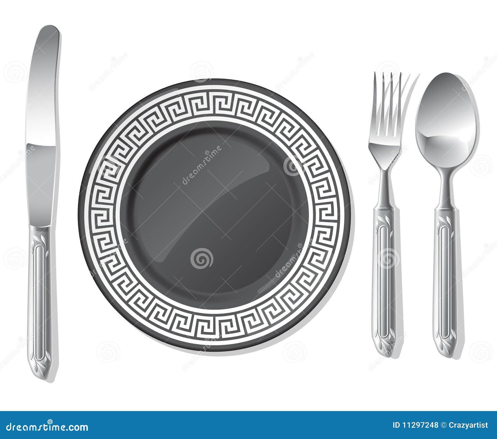 Plaque noire, cuillère argentée, fourchette, couteau