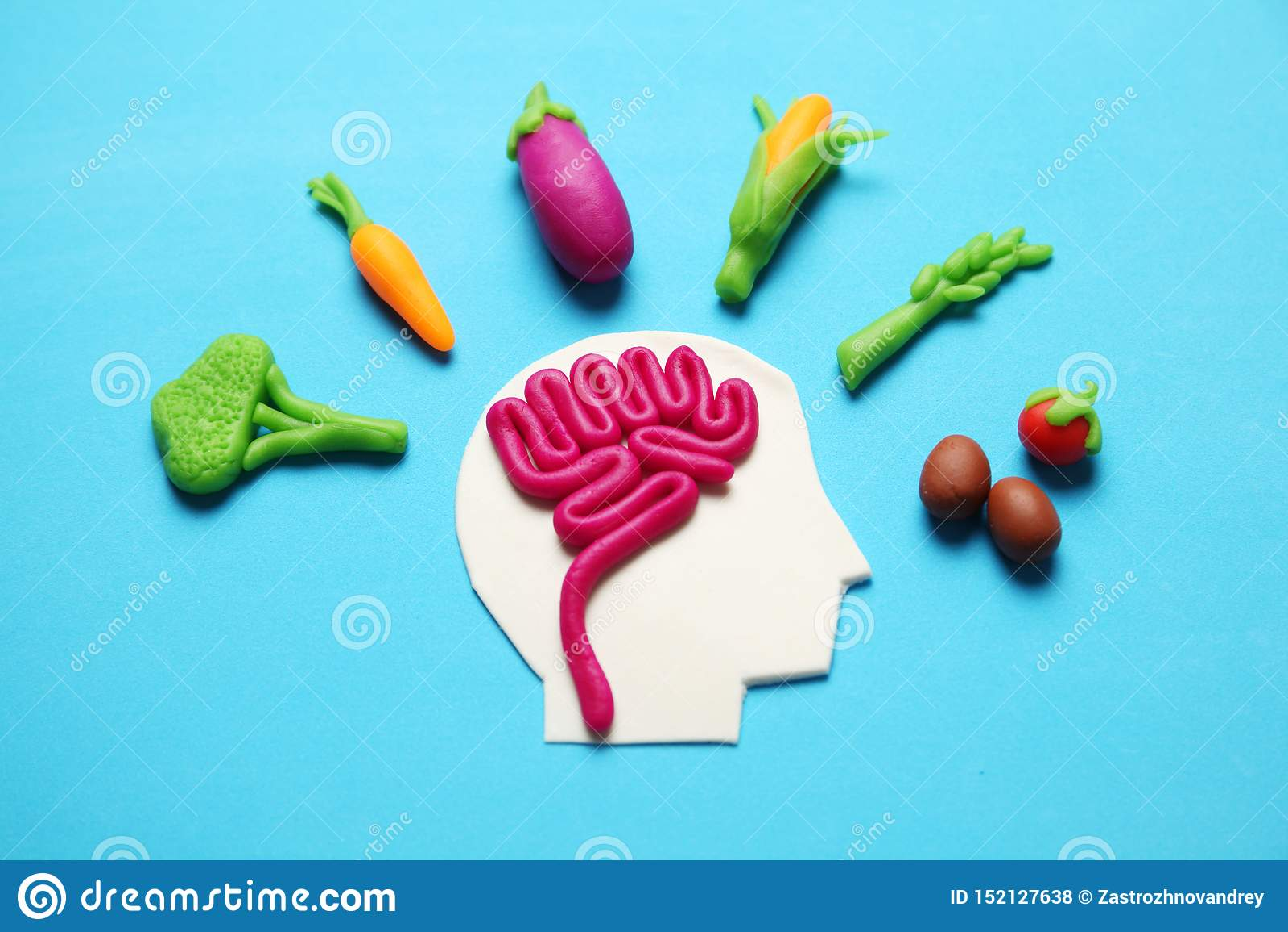 Plastellinadiagram av mannen och vegetarisk mat Mat f?r meningen, laddning av energi Sund livsstil, detoxification och antioxidan