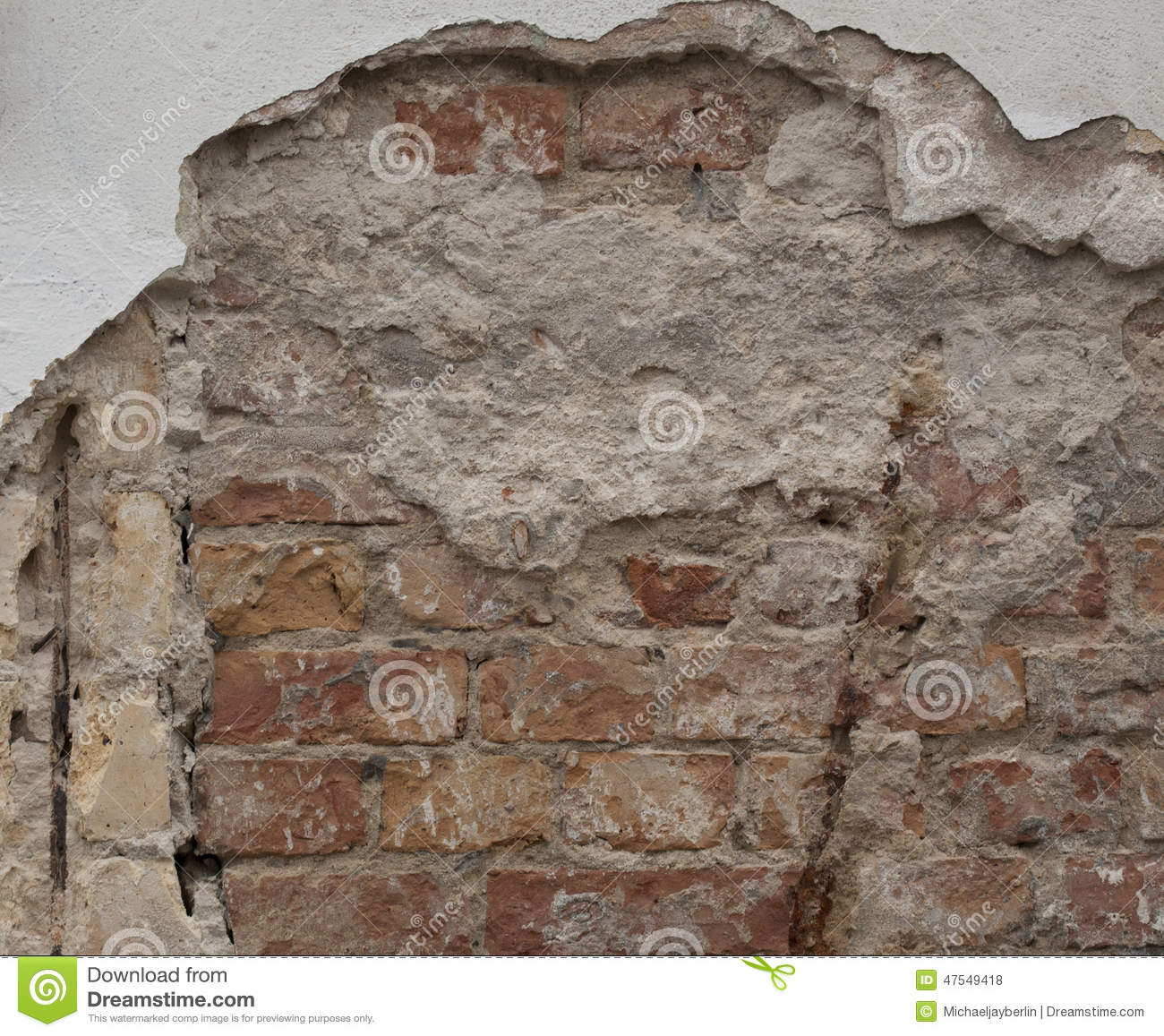 Plaster Coming Off A Brick And Mortar Wall Stock Photo
