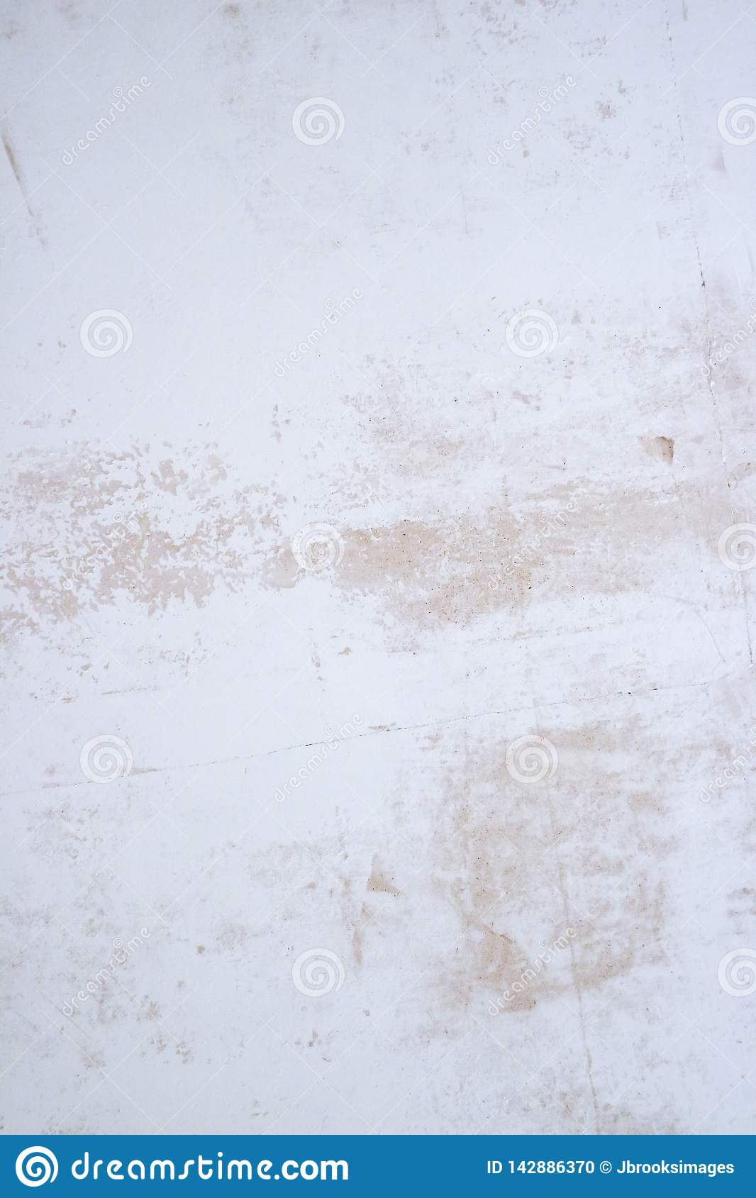 Plastered wall texture with flakes of paint and filler. Sanded surface with imperfections.