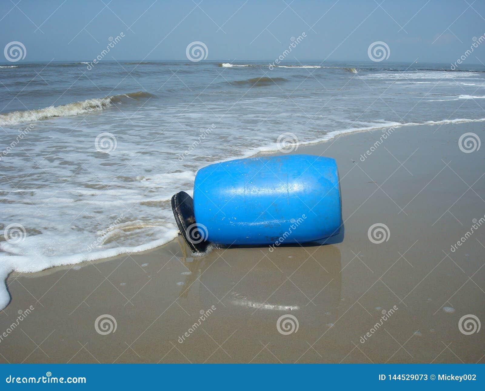 Plastic barrel on the beach