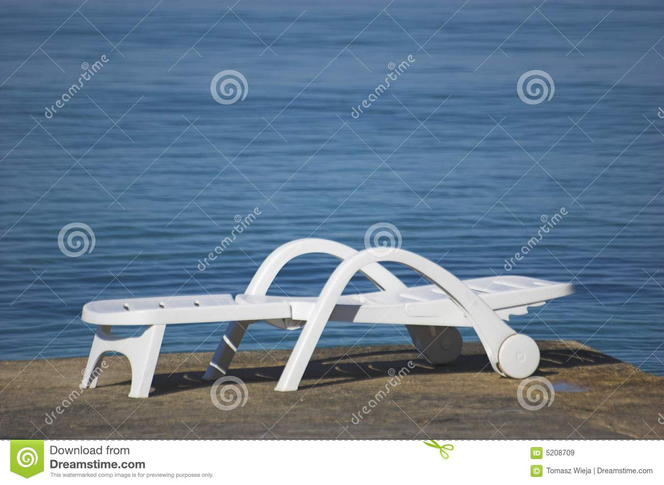 Plastic beach chair - Plastic Beach Chair Royalty Free Stock Images