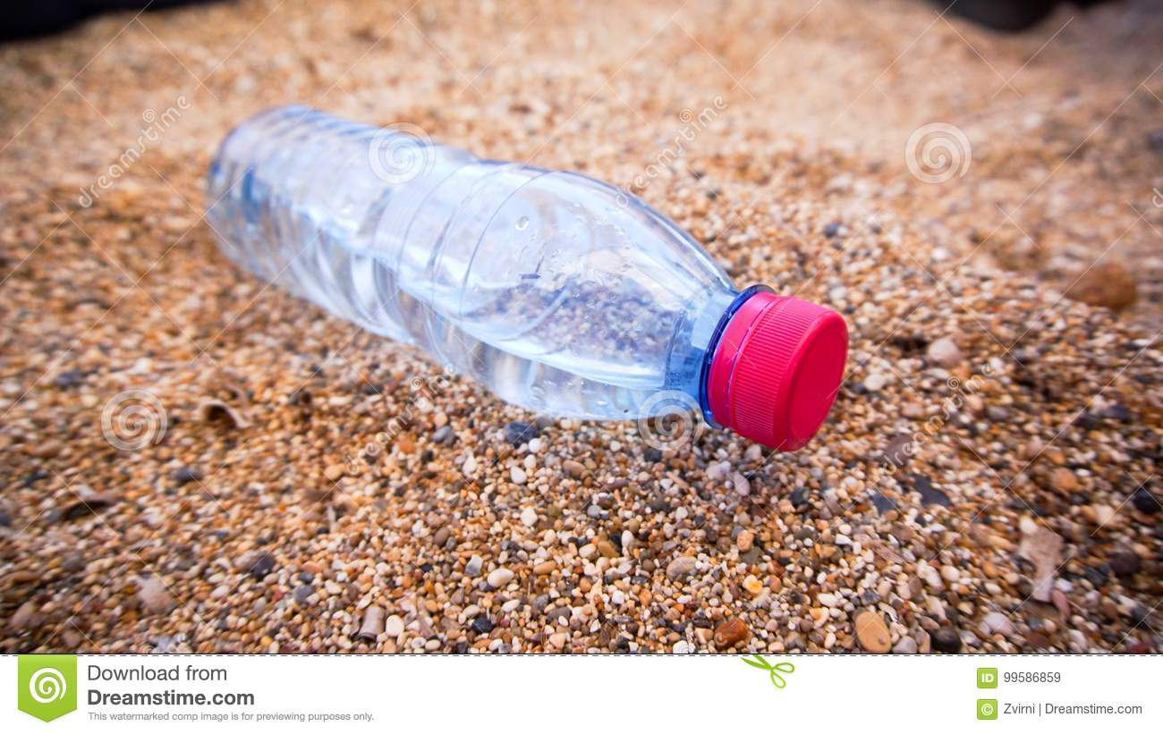 Plastic bottle in the sand