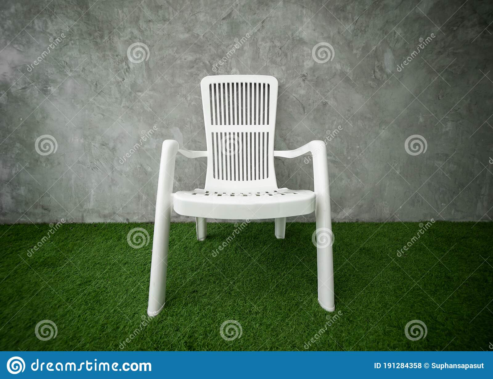 Plastic Chair On Green Glass With Copy Space Stock Photo - Image