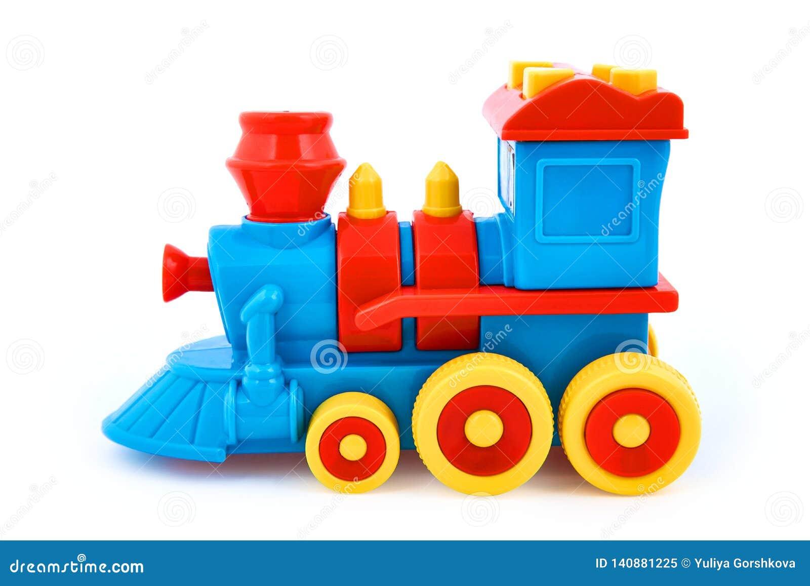 Plastic children`s toy locomotive isolated on white background
