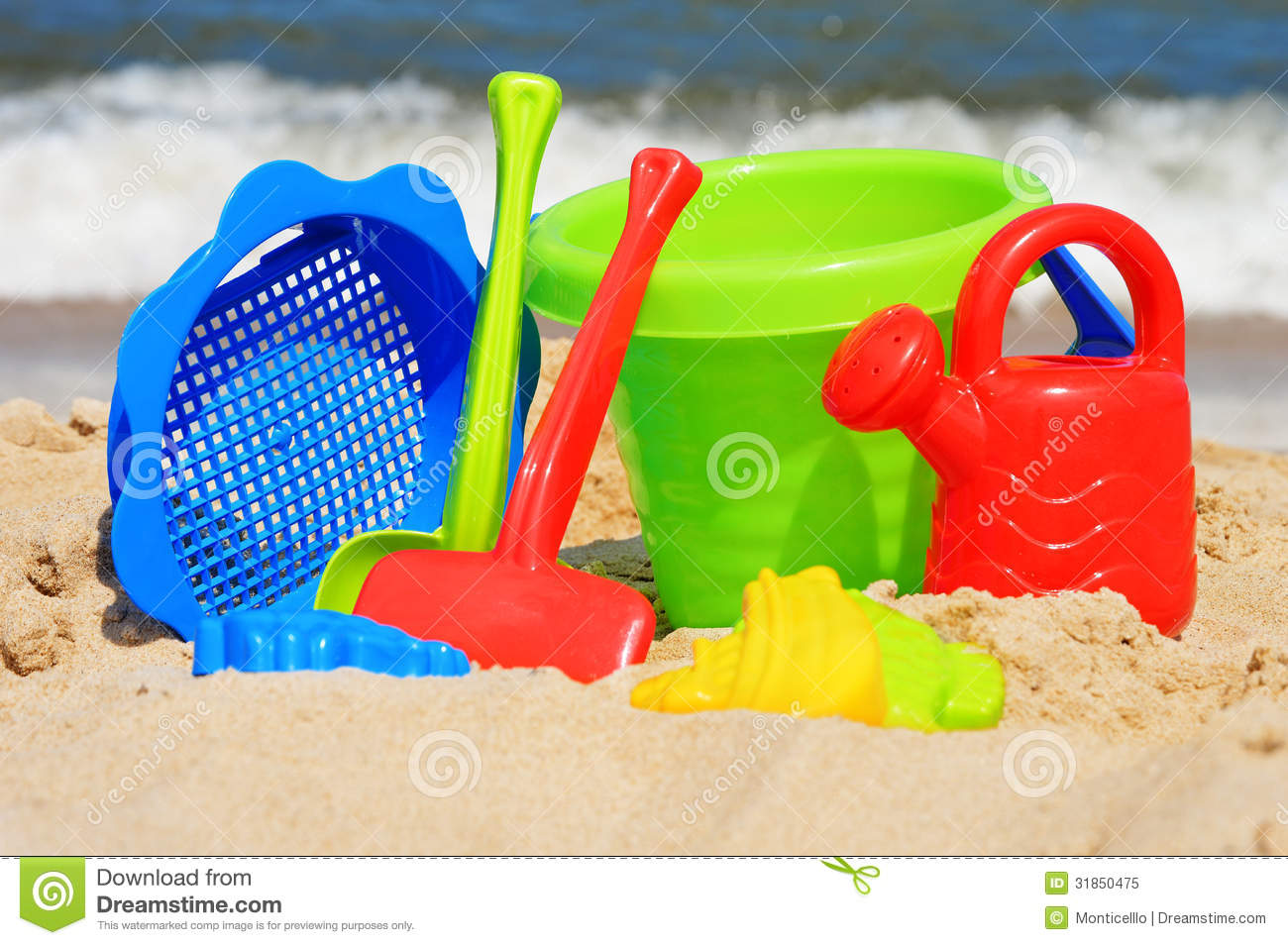 Toys For Beach : Plastic children toys on the beach stock image
