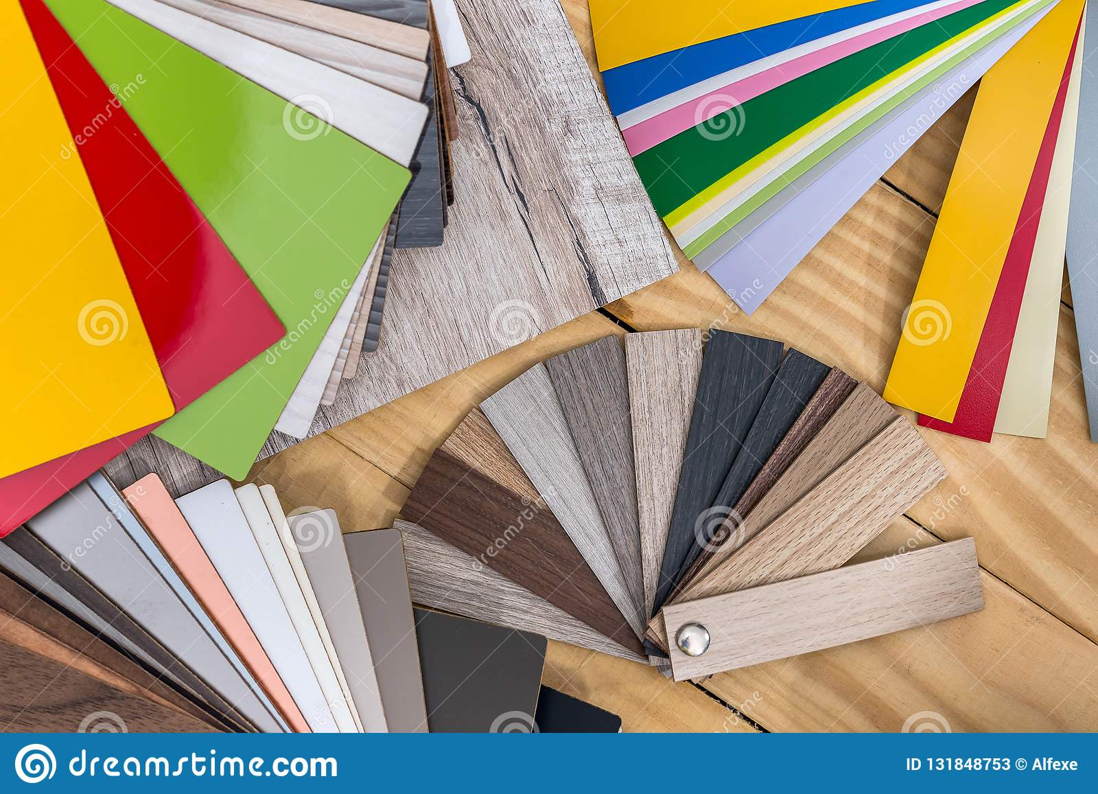 Plastic colour swatches for furniture on wooden background