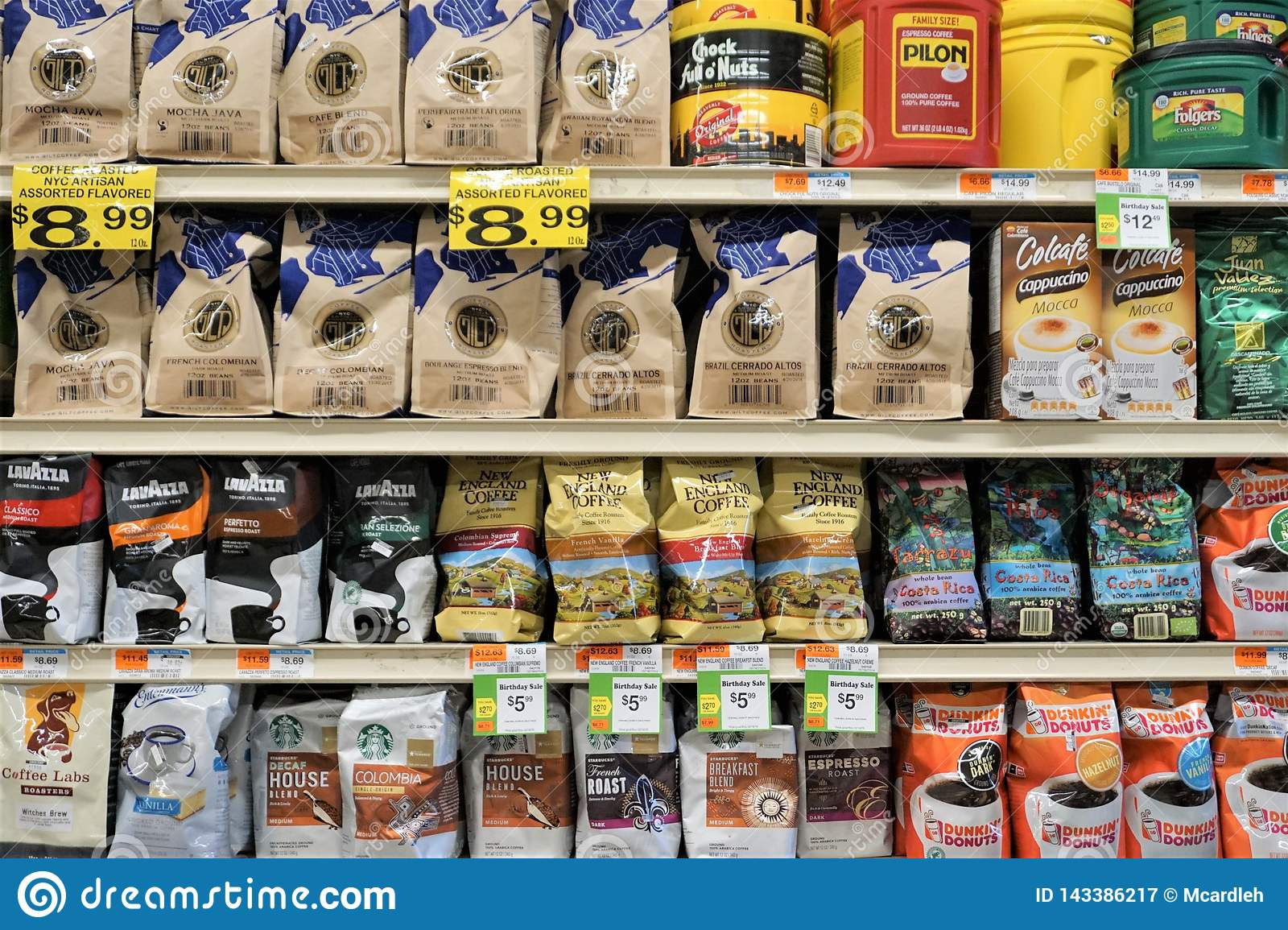 Bags Of Ground Coffee And Beans On Supermarket Shelves
