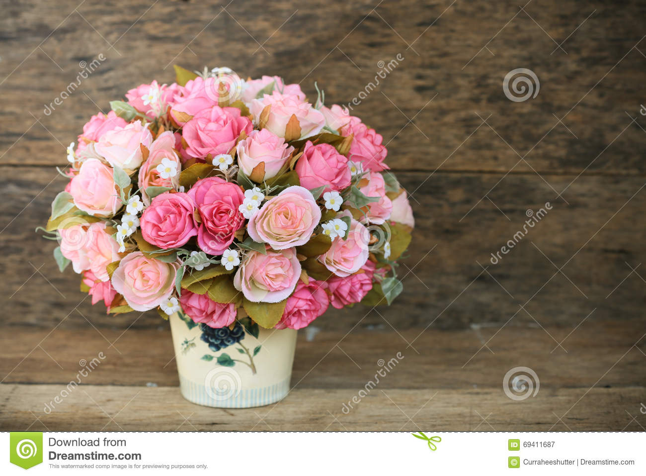 Plastic flowers with wooden background in vintage picture style, home interior equipment, Flowers set on wooden background
