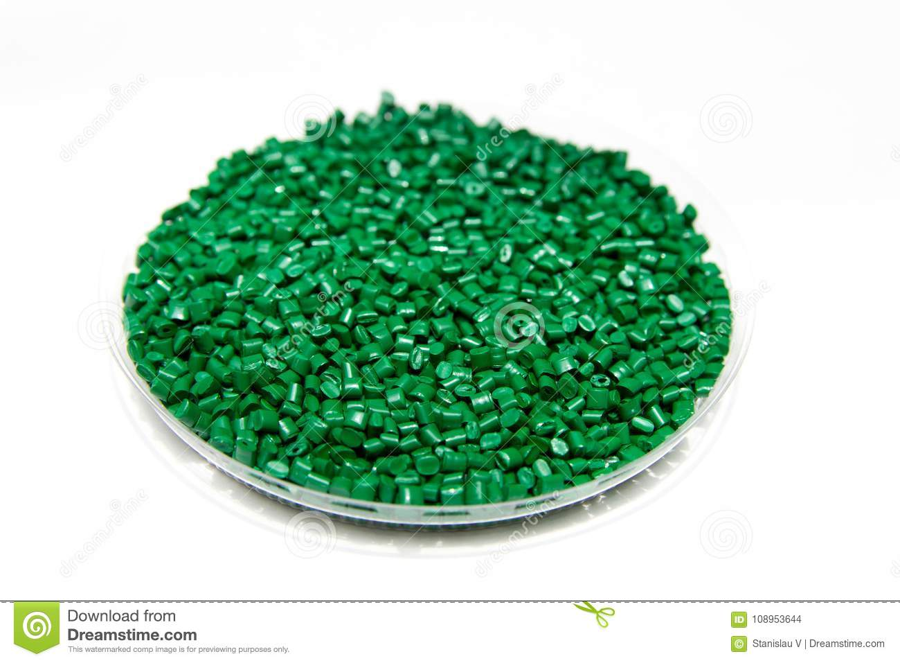 The plastic granules. Dye for polypropylene, polystyrene granules into a measuring container.