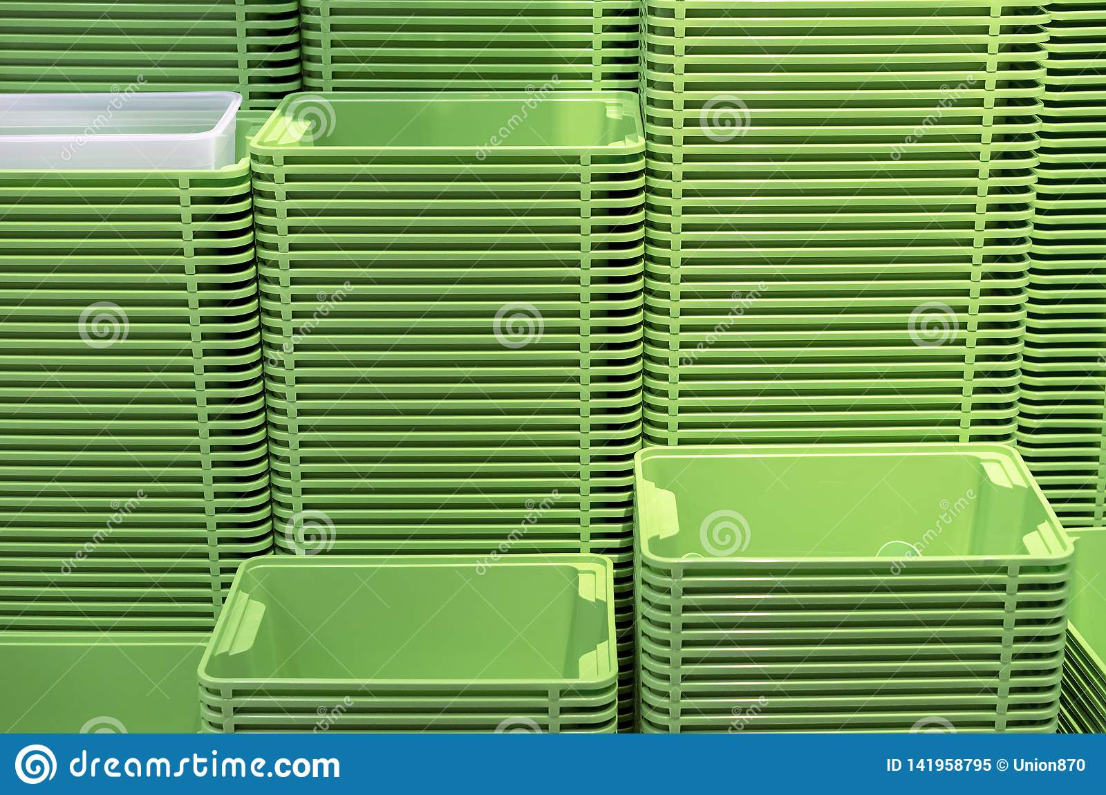 Plastic green containers stacked in several rows
