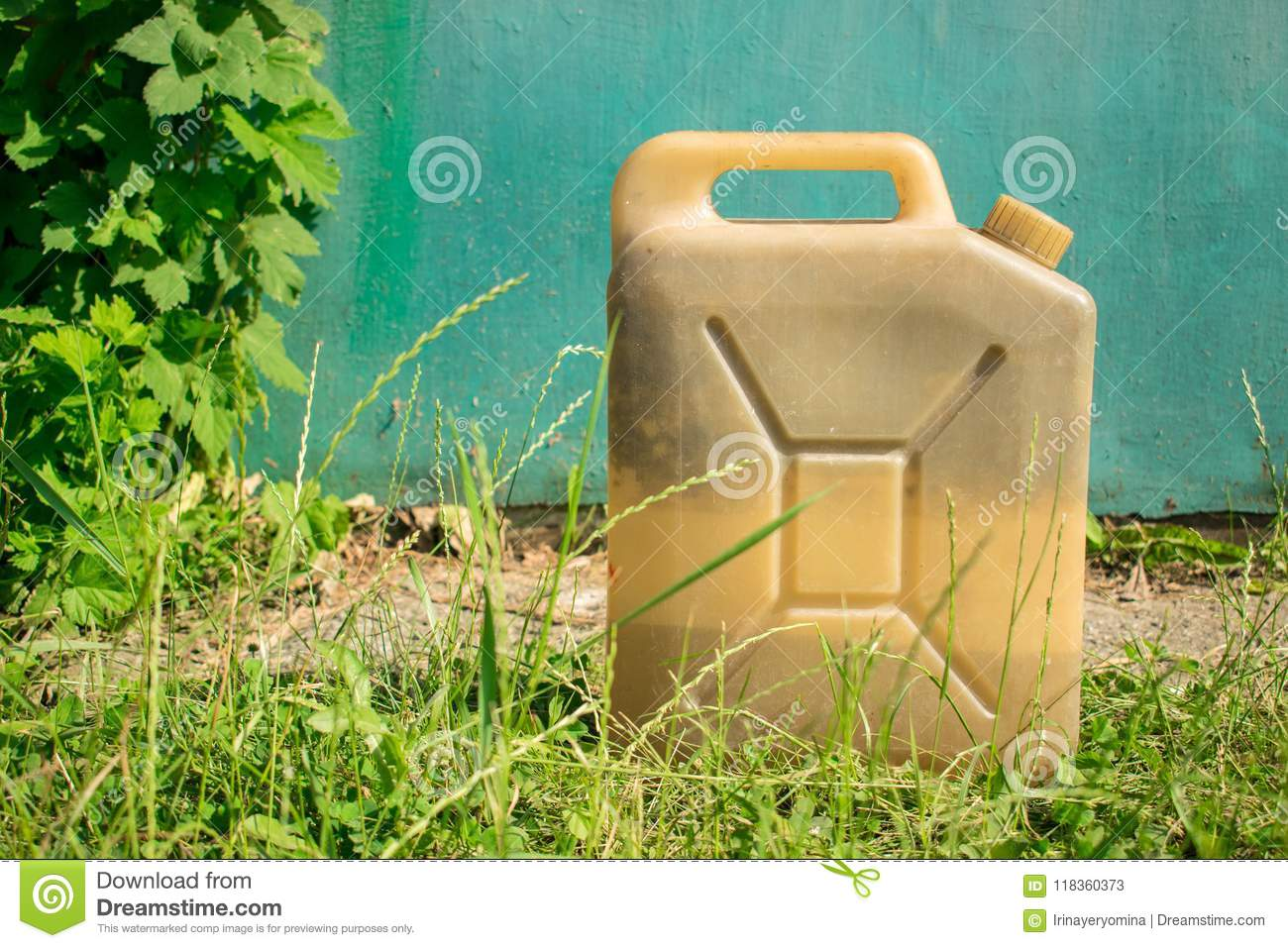 Plastic Old Vintage Canister For Liquid On The Background Of Blu