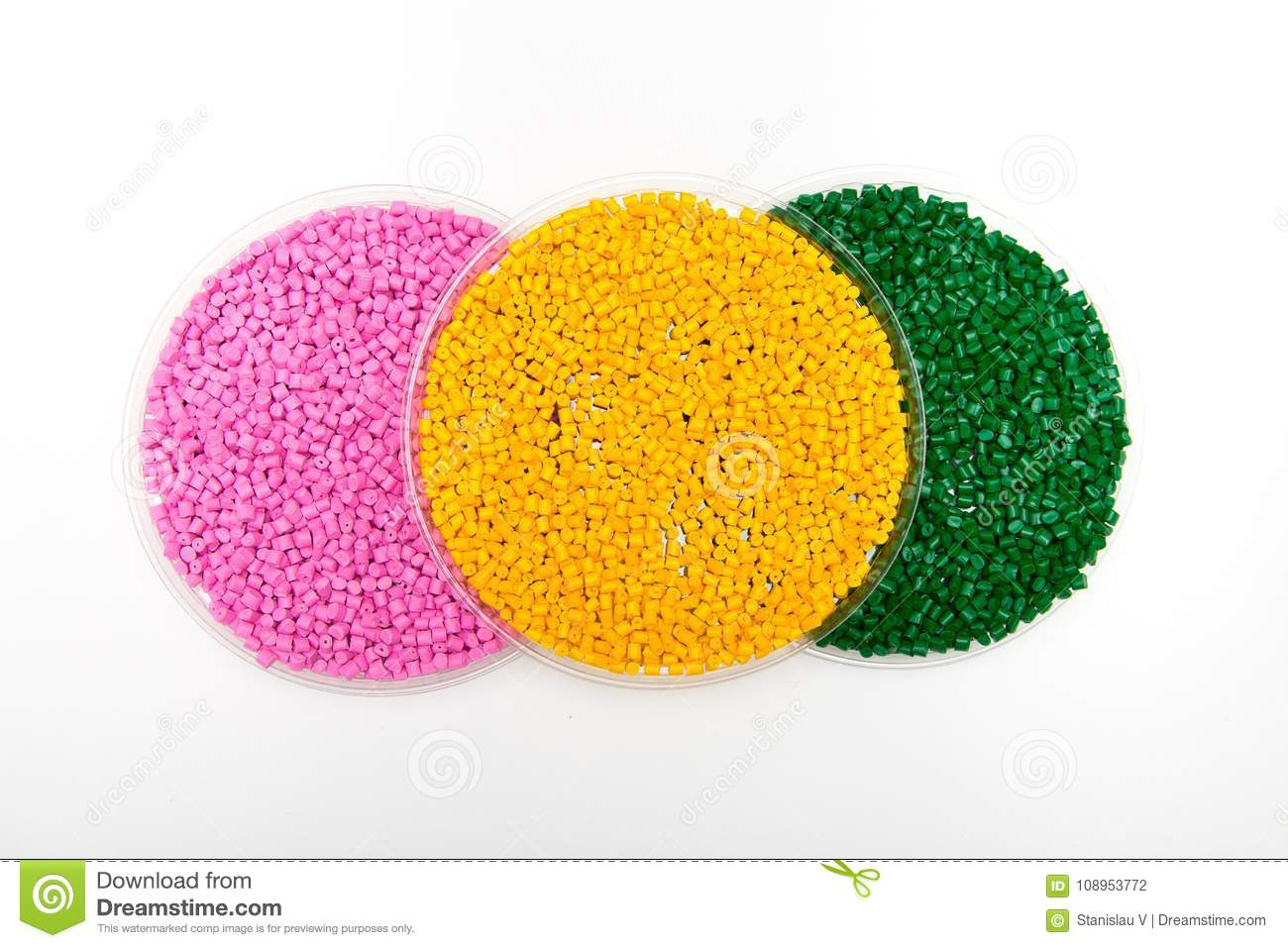 Plastic pellets . Colorant for polymers in granules. Worker wearing gloves takes plastic pellets with tweezers
