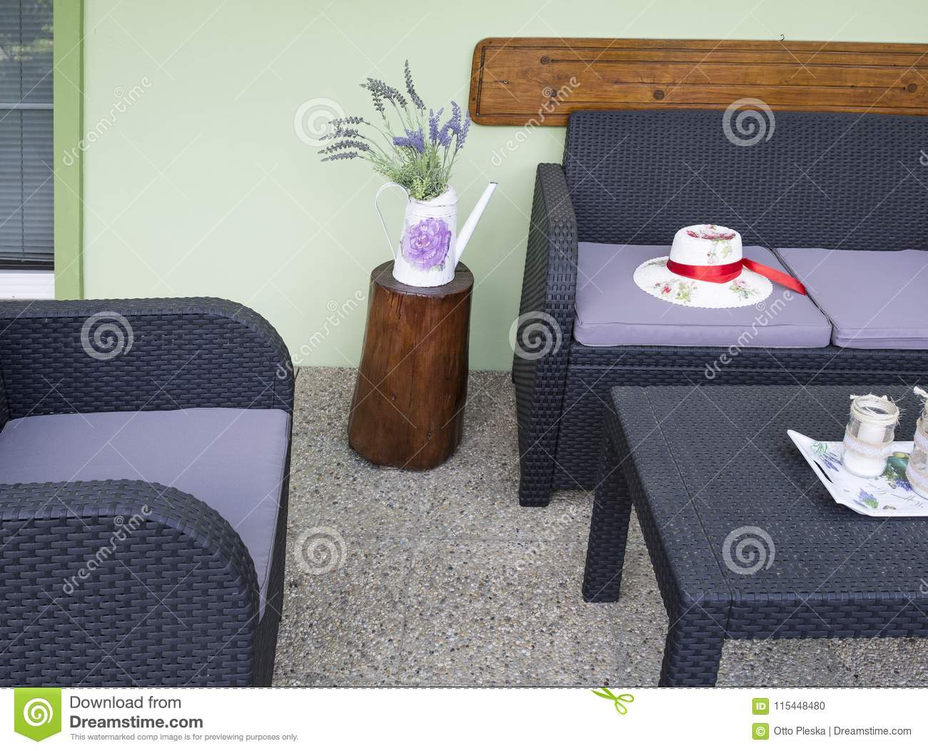 Plastic rattan patio furniture with rustic decoration