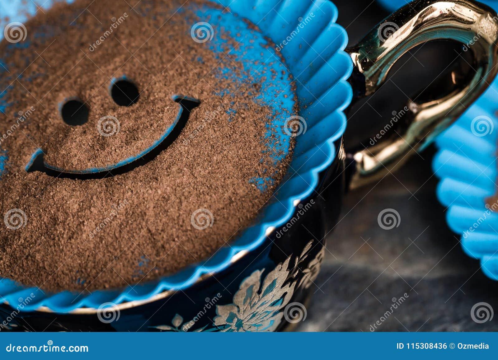 plastic smiley face template to put powder cinnemon stock photo