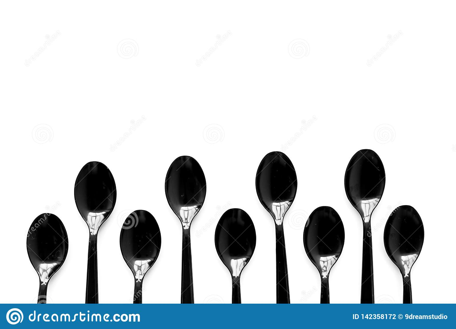 Plastic Spoons For Eco And Earth Protection Concept On White