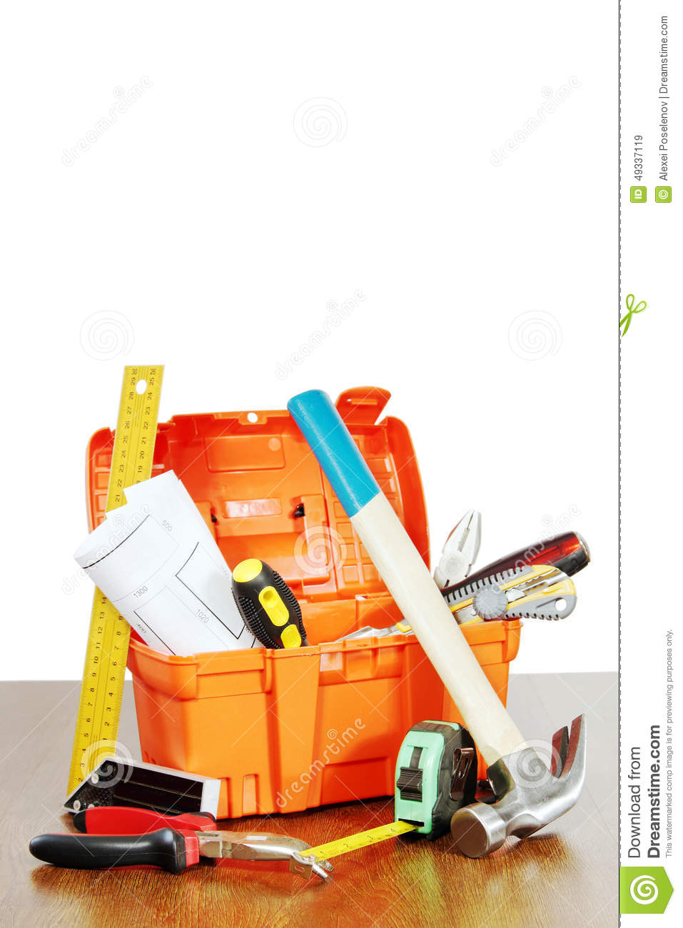 Plastic toolbox with various working tools stands on a table
