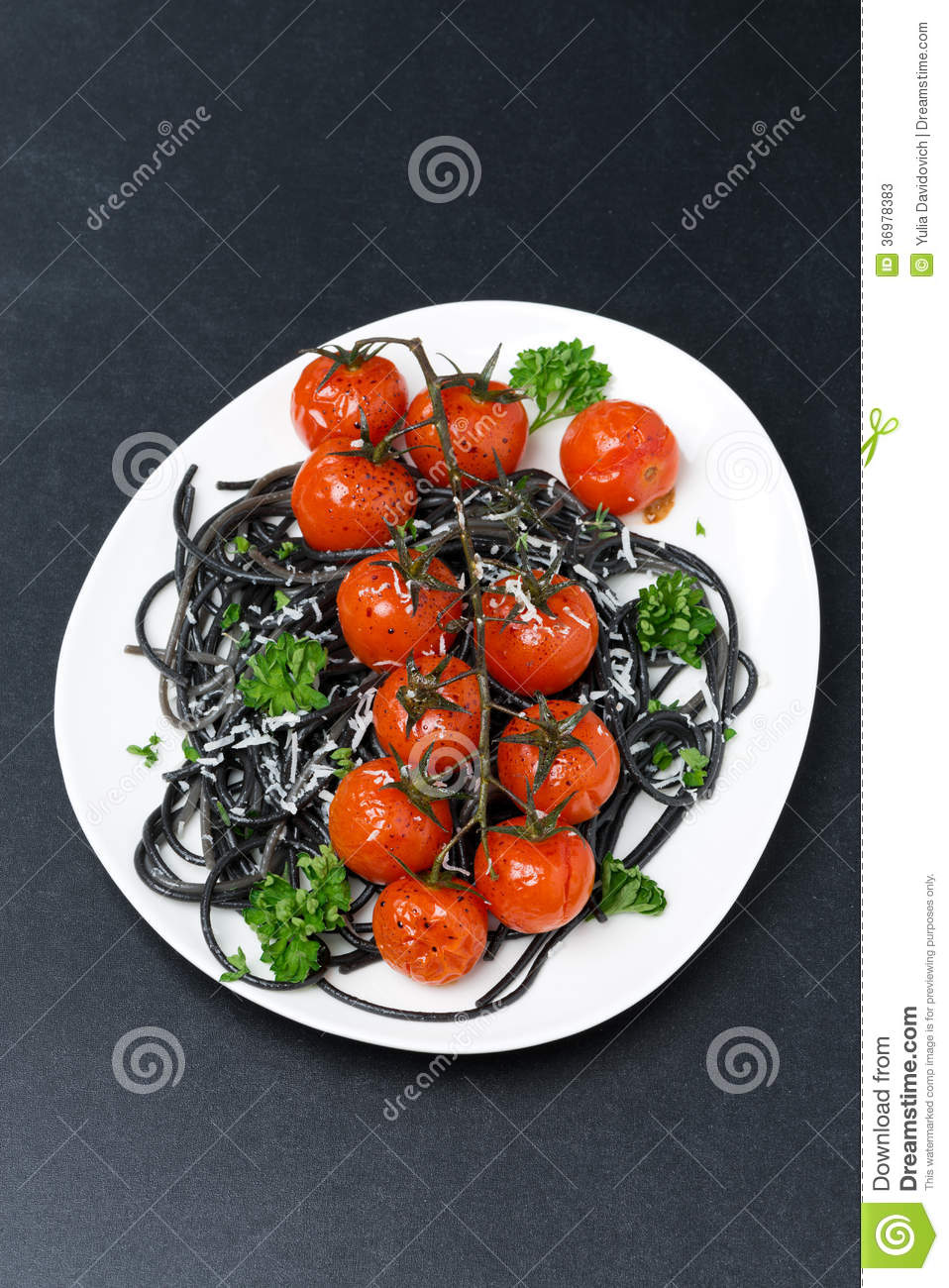 Plate Of Black Pasta With Baked Tomatoes, Parmesan Cheese Stock Photos ...