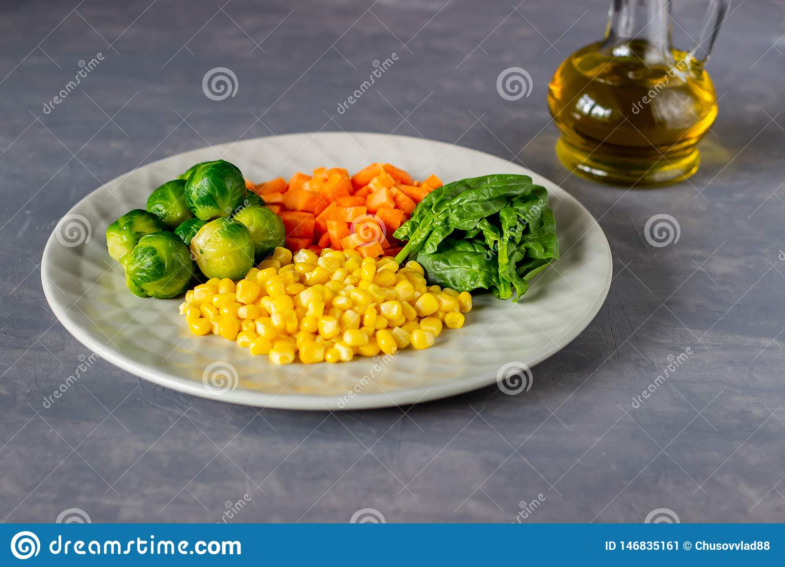 Plate with cabbage, carrots, corn and spinach. Healthy eating