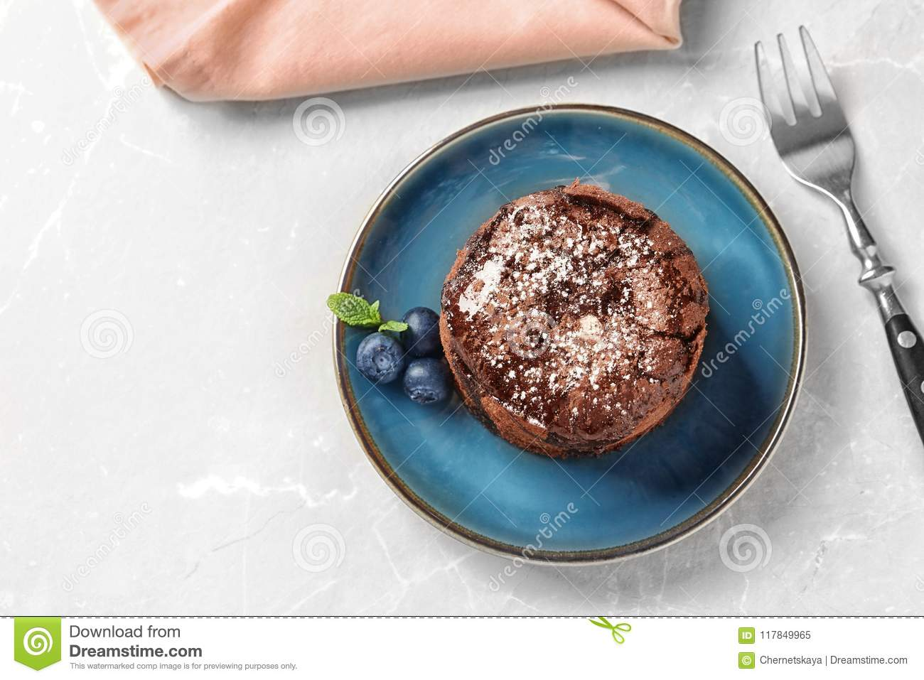 Plate of delicious fresh fondant with hot chocolate