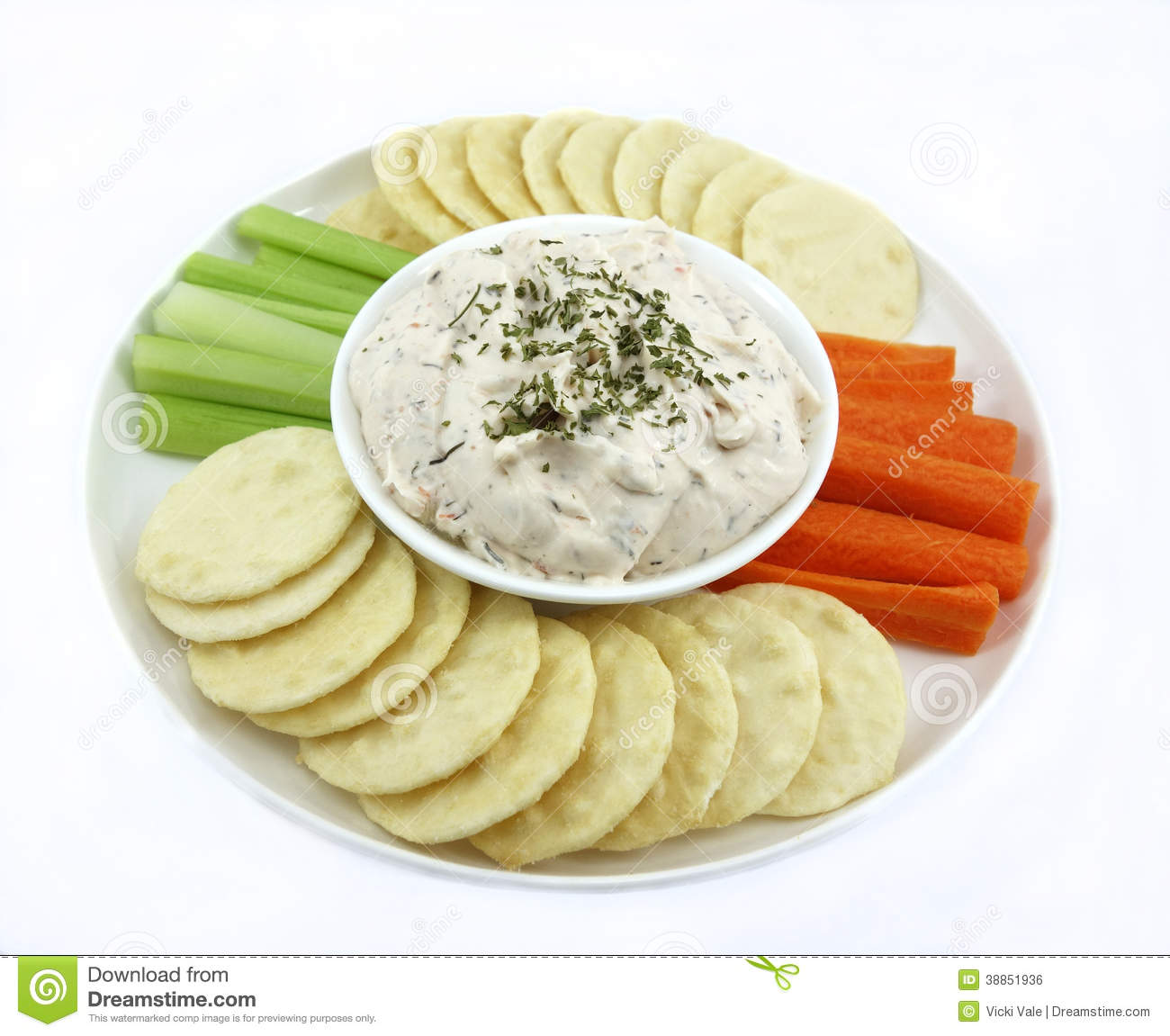 ... with dry biscuits surround a small bowl of creamy salmon and dill dip
