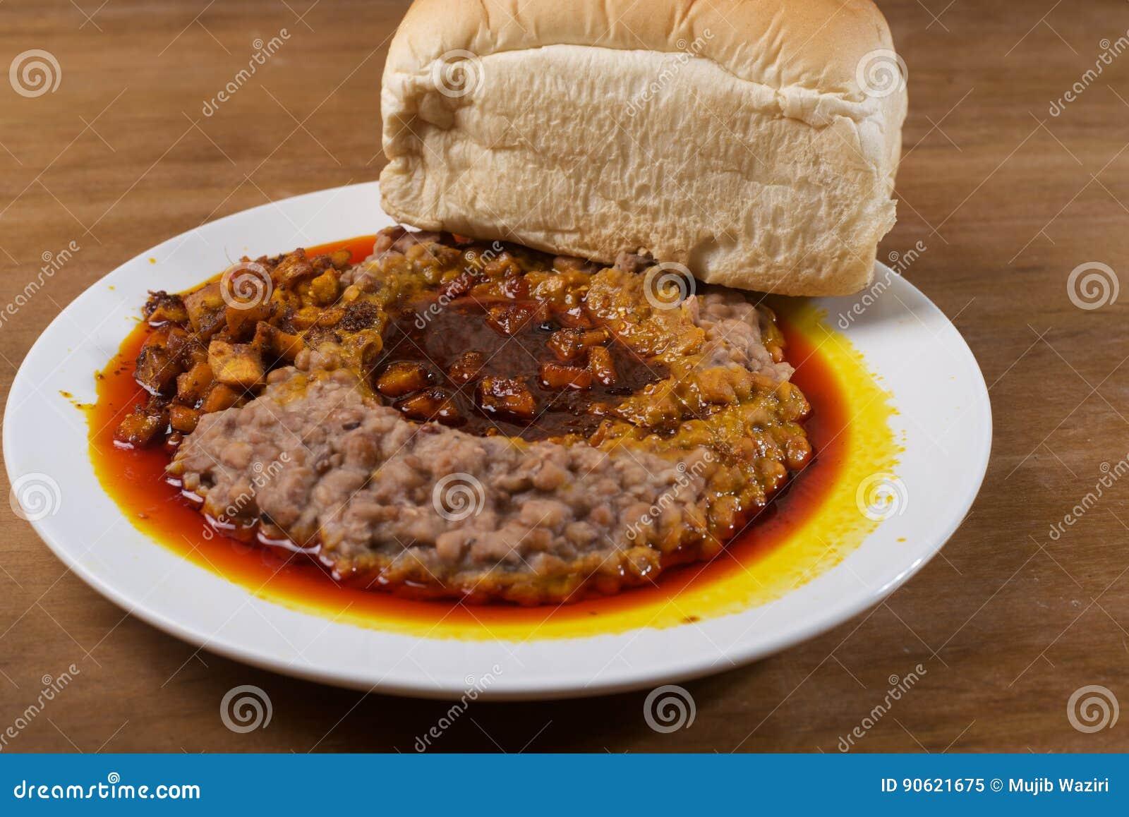 A plate of ewa agoyin and agege bread