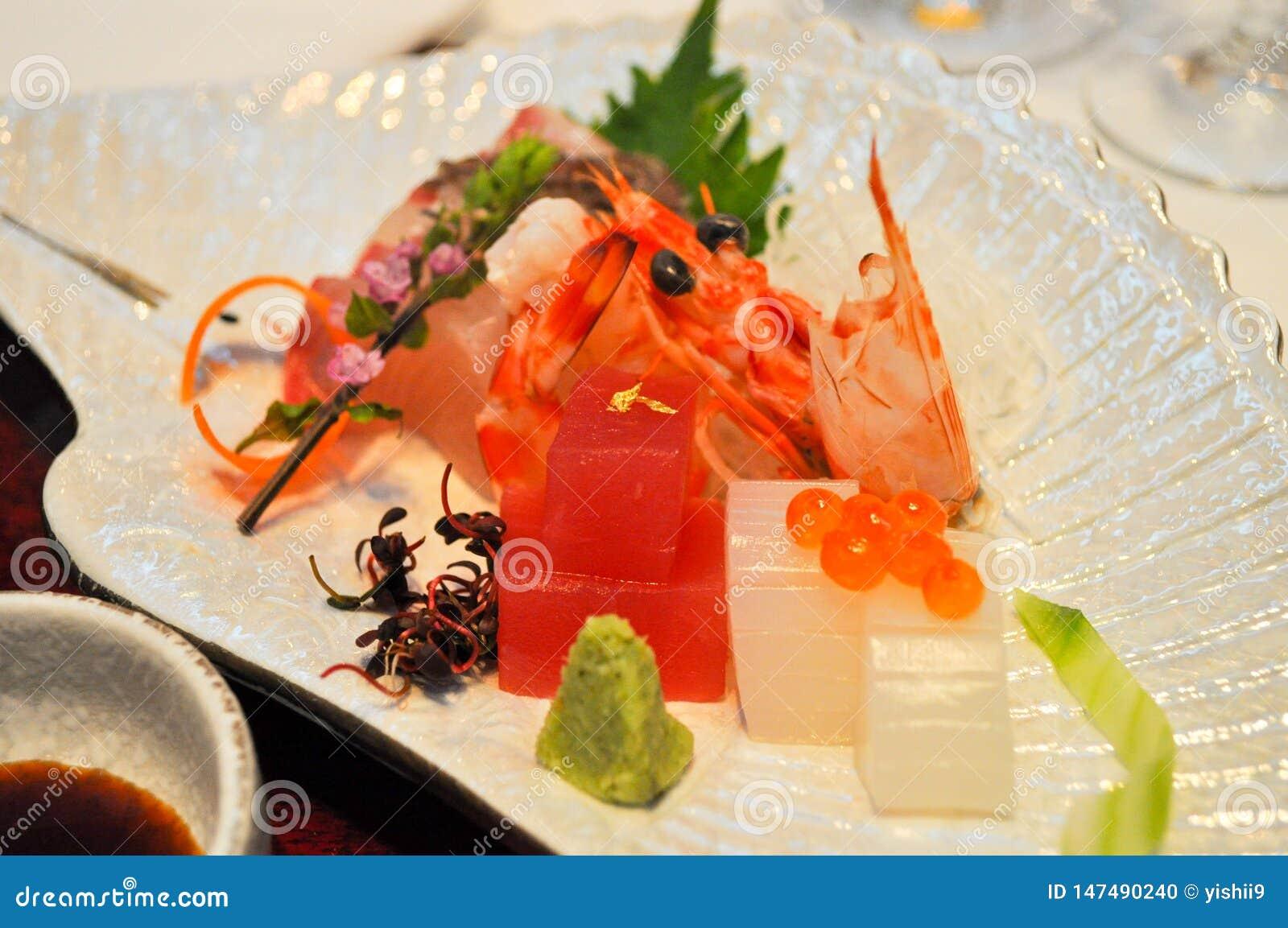 A dish of fish, squid, and shrimp sashimi