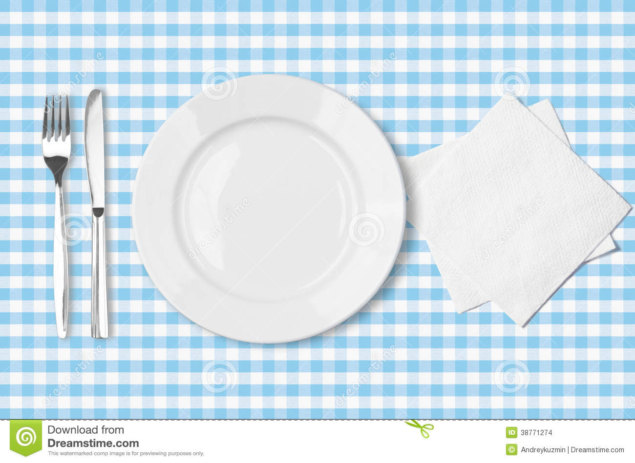 Plate Fork Knife And Napkin Over Blue Tableclot Stock