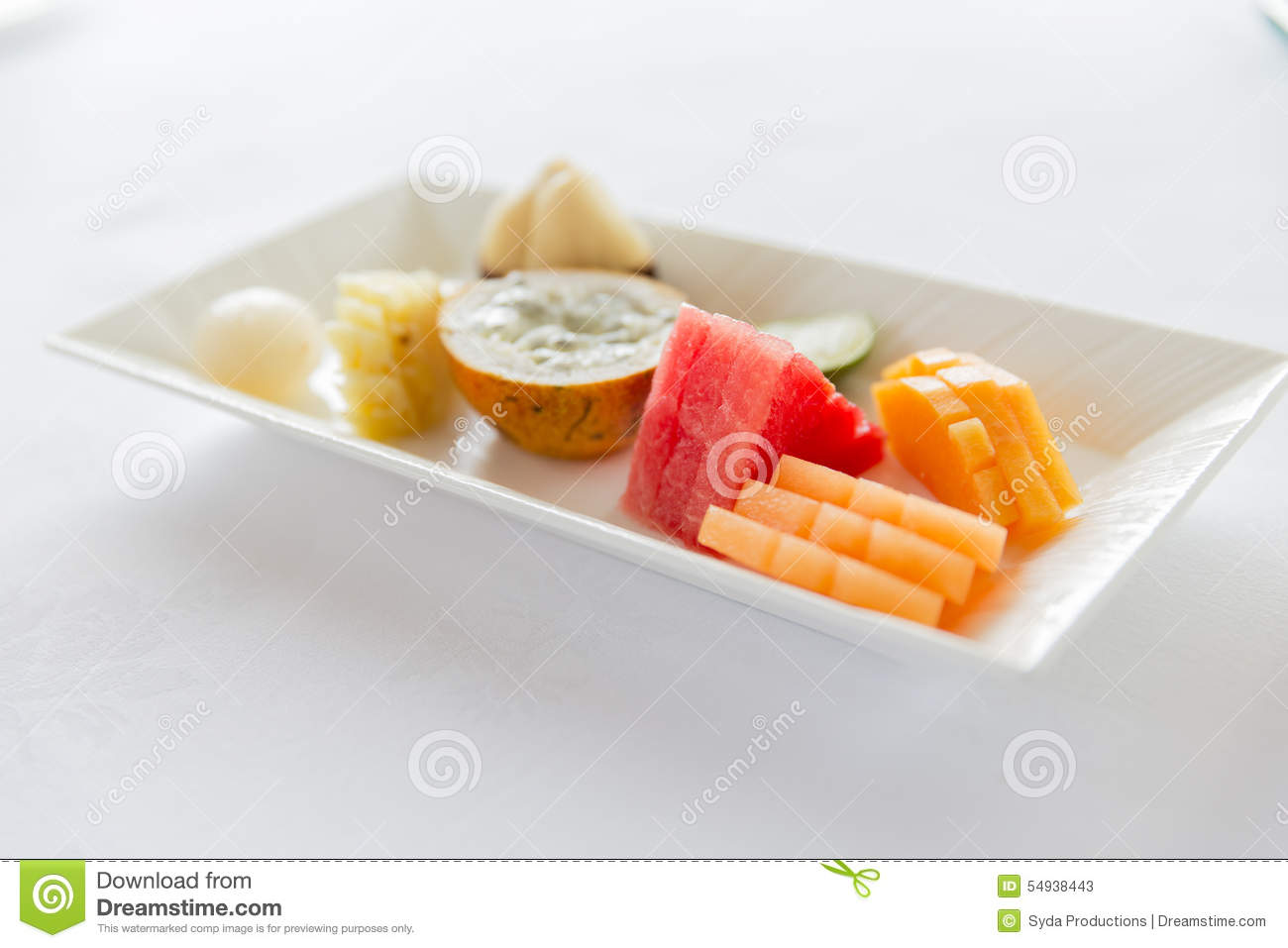 Plate Of Fresh Juicy Fruit Dessert At Restaurant Stock Image - Image ...