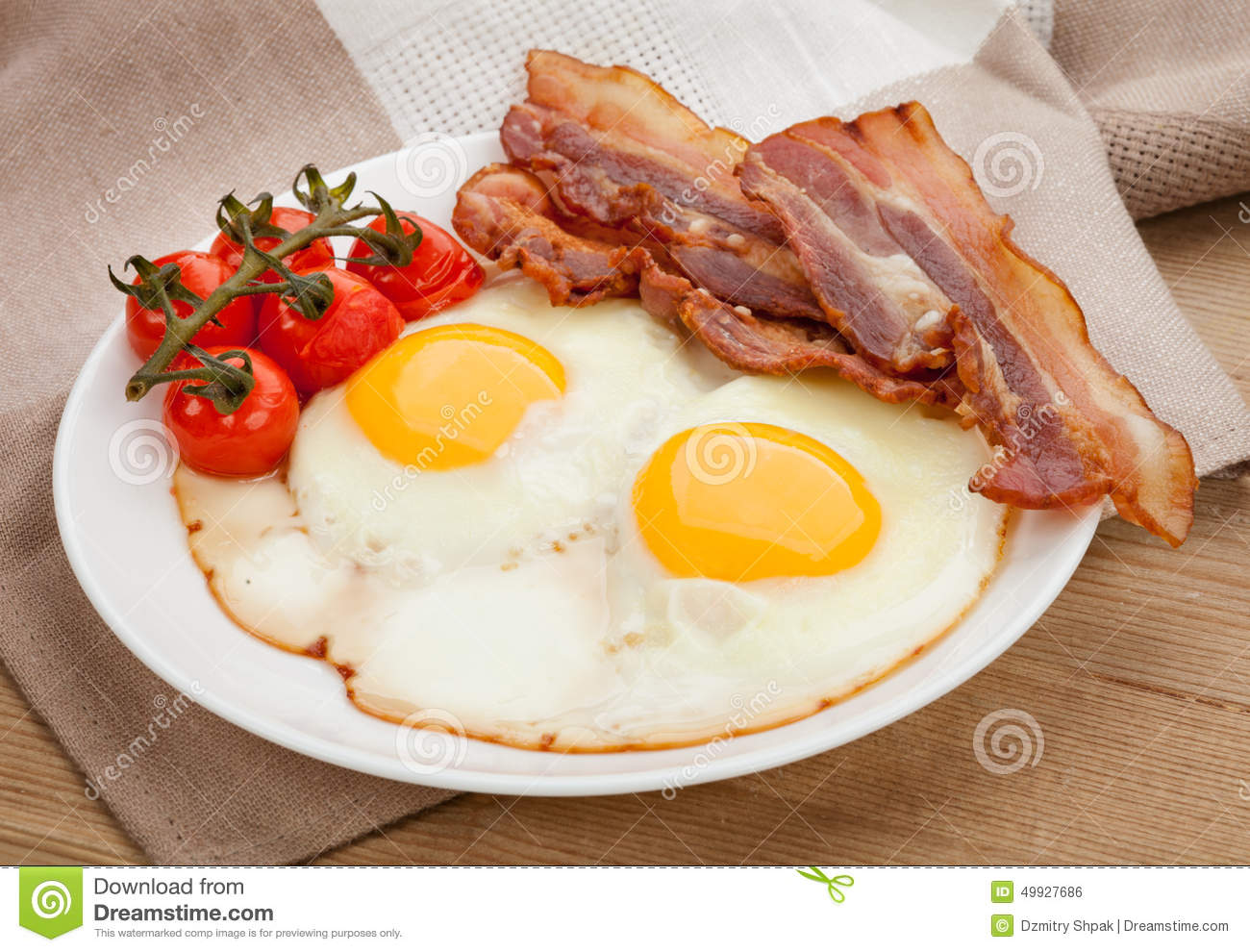 Plate With Fried Eggs, Bacon On Board Stock Photo - Image ...  |Fried Eggs On A Plate