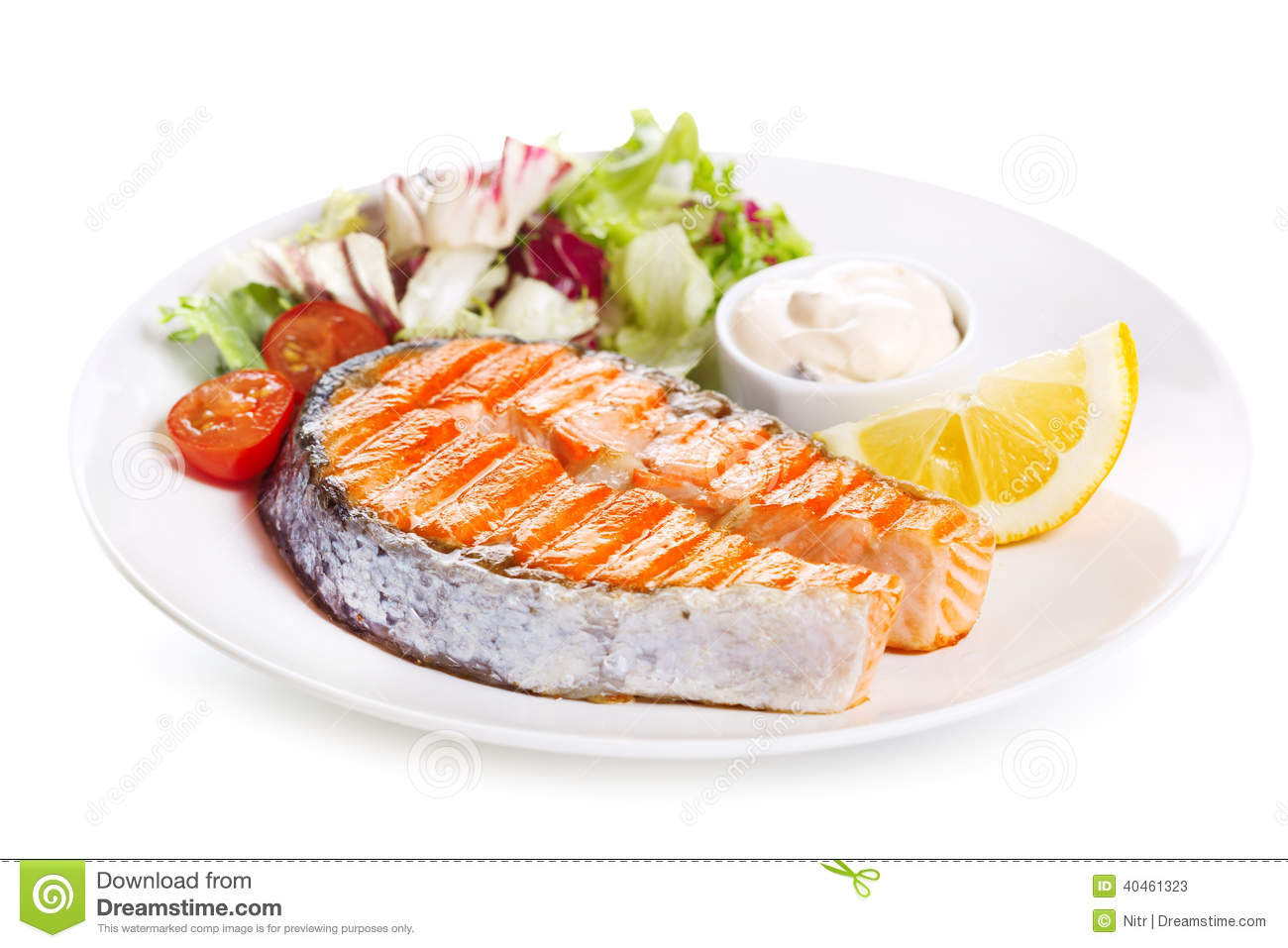 Plate of grilled salmon steak with vegetables