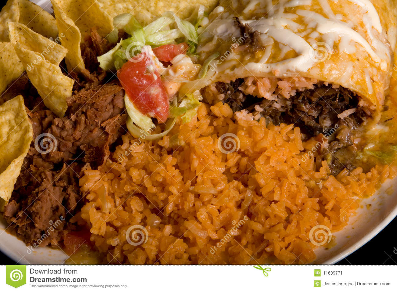 very delicious Plate of Mexican food. On a white plate with a close ...