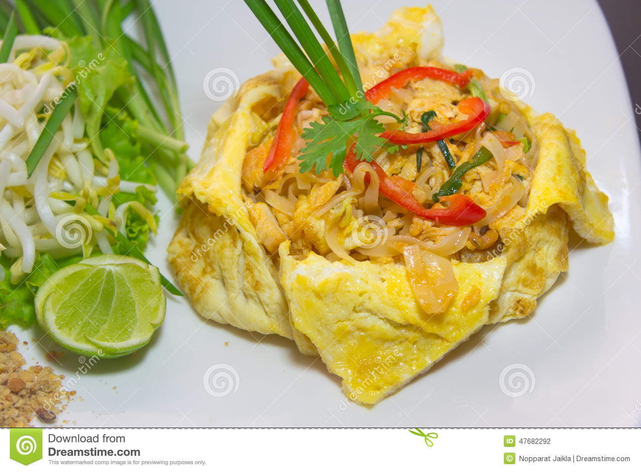 Plate Of Pad Thai Or Phat Thai In Omelette Stock Photo - Image ...