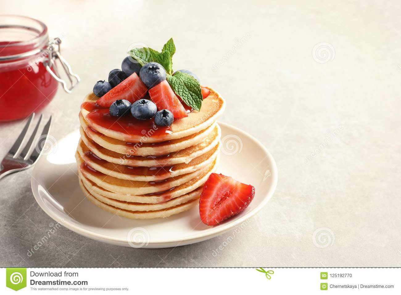 Plate with pancakes and berrie
