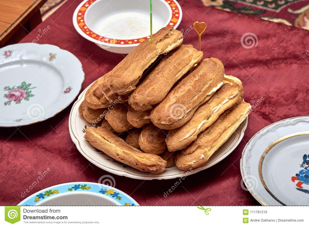 On the plate there are several home-made eclairs.