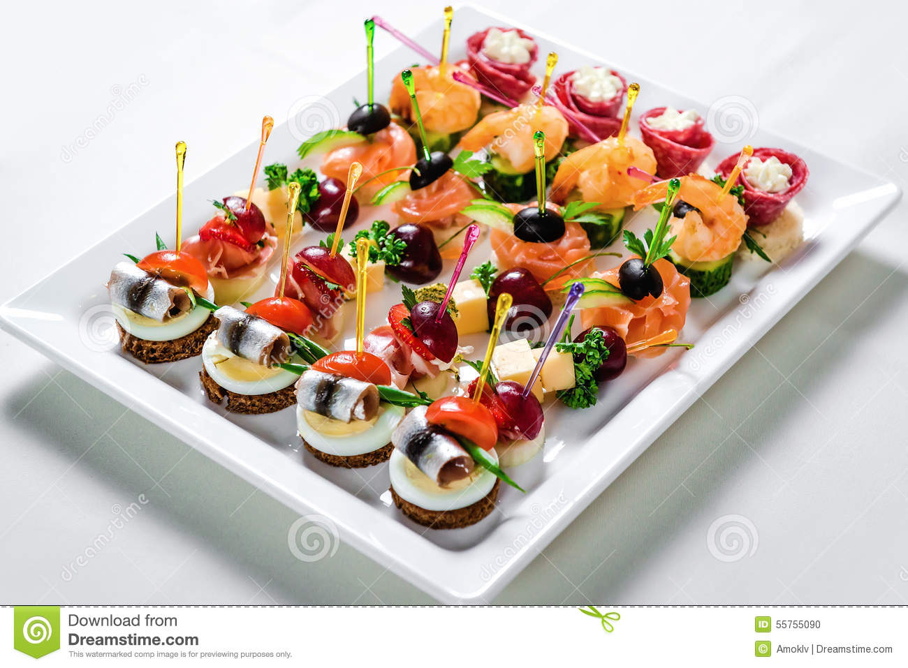 Plate with various seafood and meat canapes stock photo for What is a canape plate