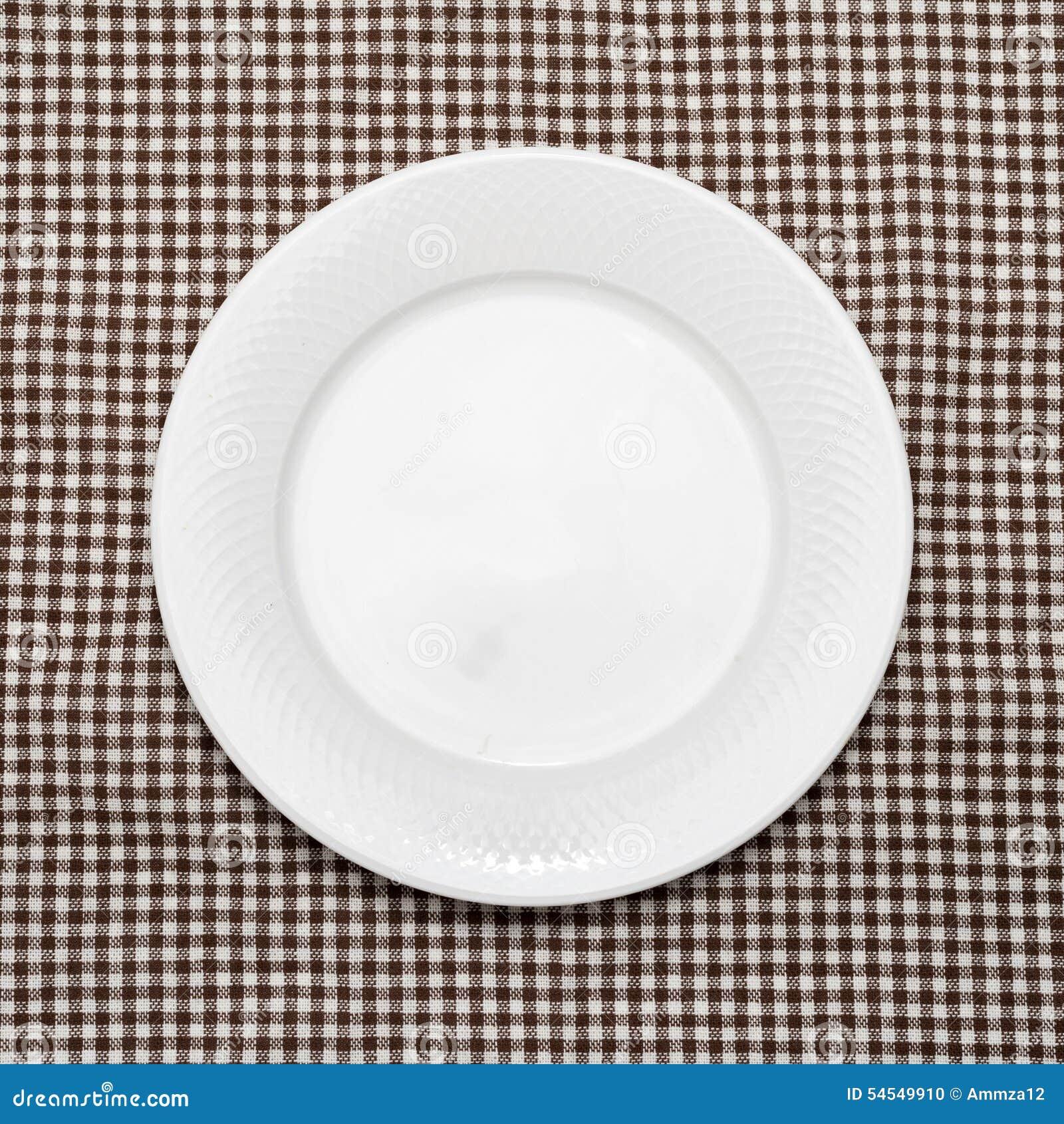 Plato vac o en la toalla de cocina foto de archivo for Platos cocina